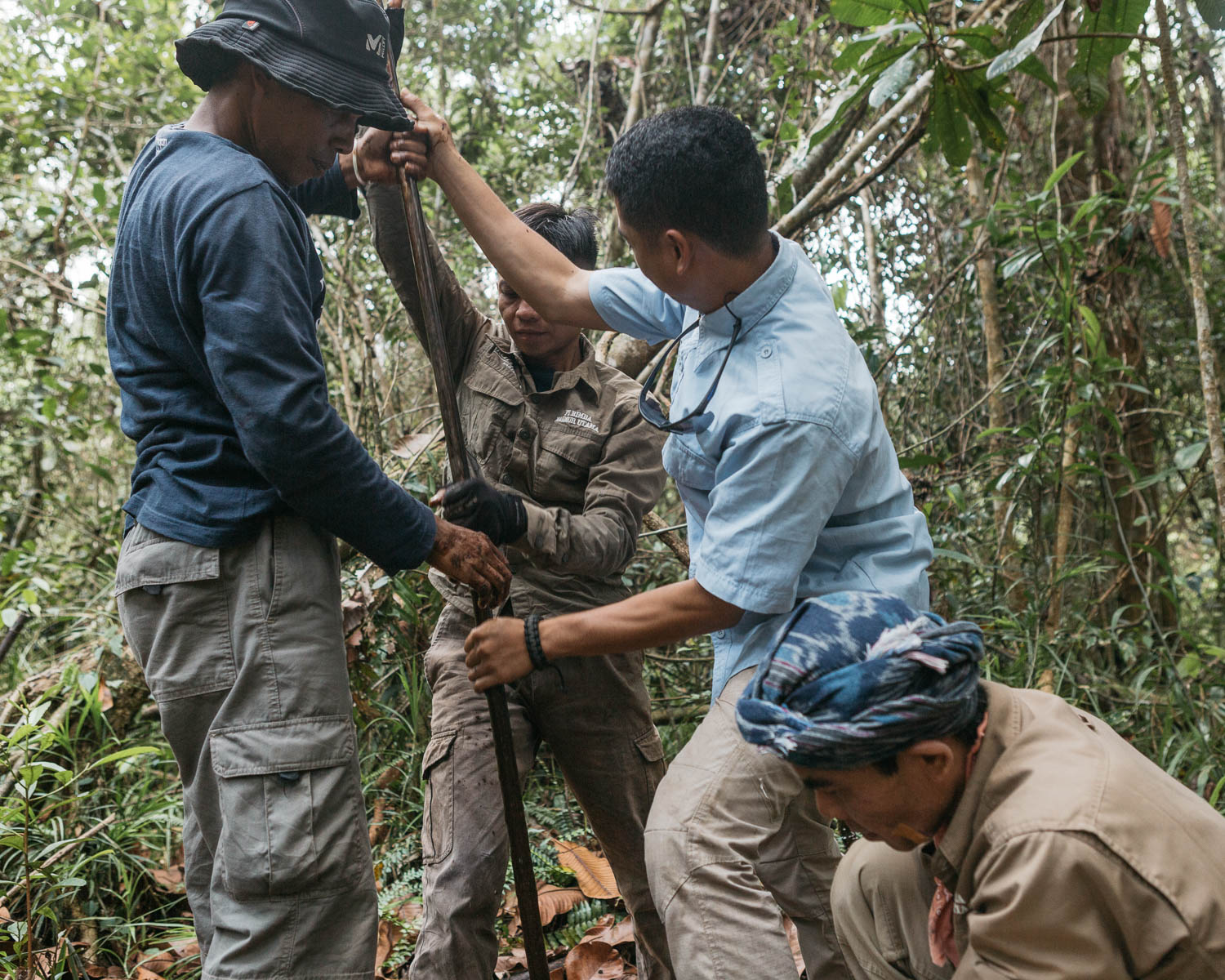 Staffs from PT Rimba Makmur Utama measure the depth of peat composition in the forest in Hantipan. In this area, more than 3 meters of peat detected before touching the real soil.