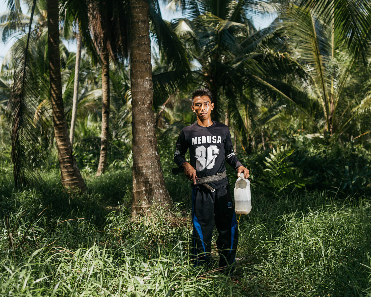 Portrait of Juhrani who had just learn how to climb coconut tree to collect the sap for making coconut palm sugar. PT Rimba Mamkur Utama runs a program where the local community can learn of how to make coconut palm sugar to increase the value of the local commodity.