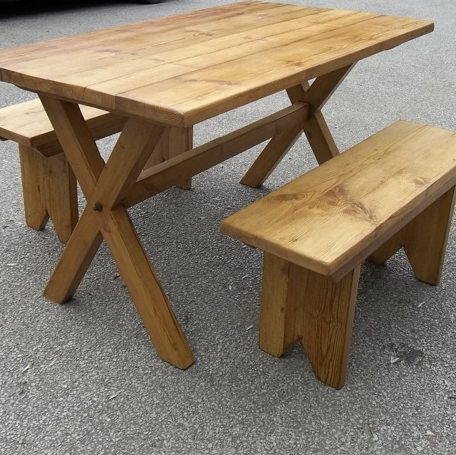 Trestle style pine table with benches made from old pine floorboards