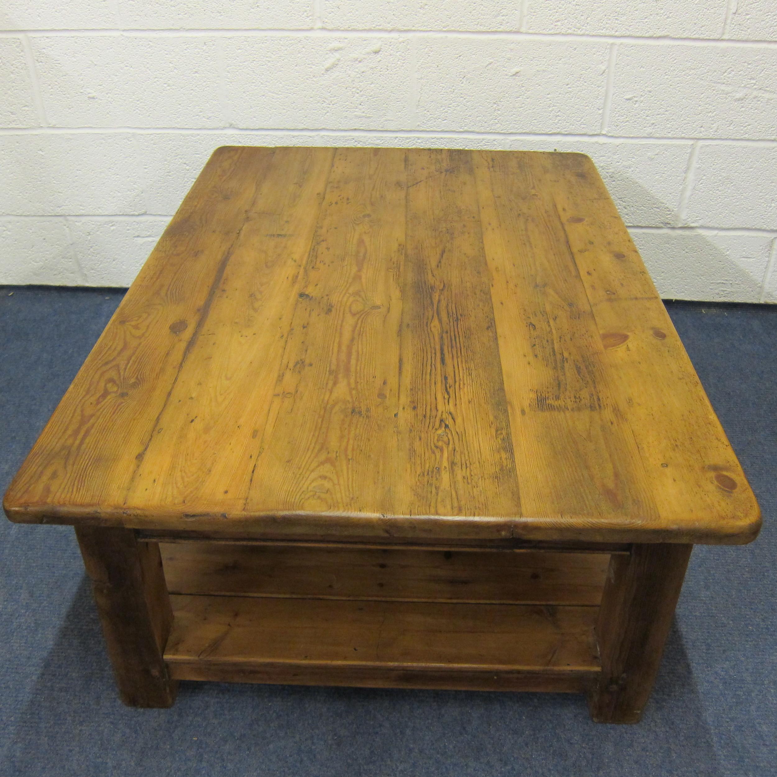 Waxed old pine floorboard table top