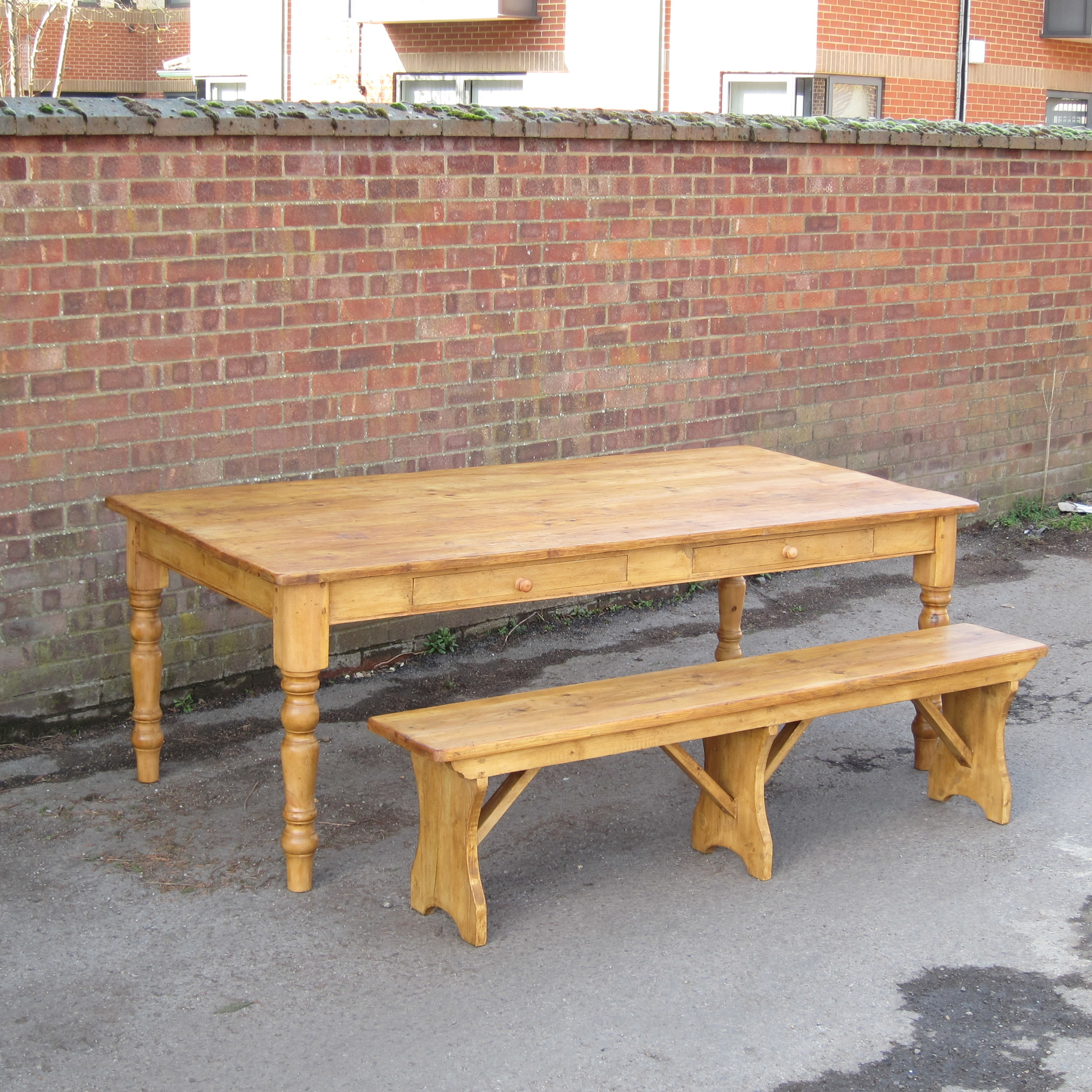 large pine table and bench