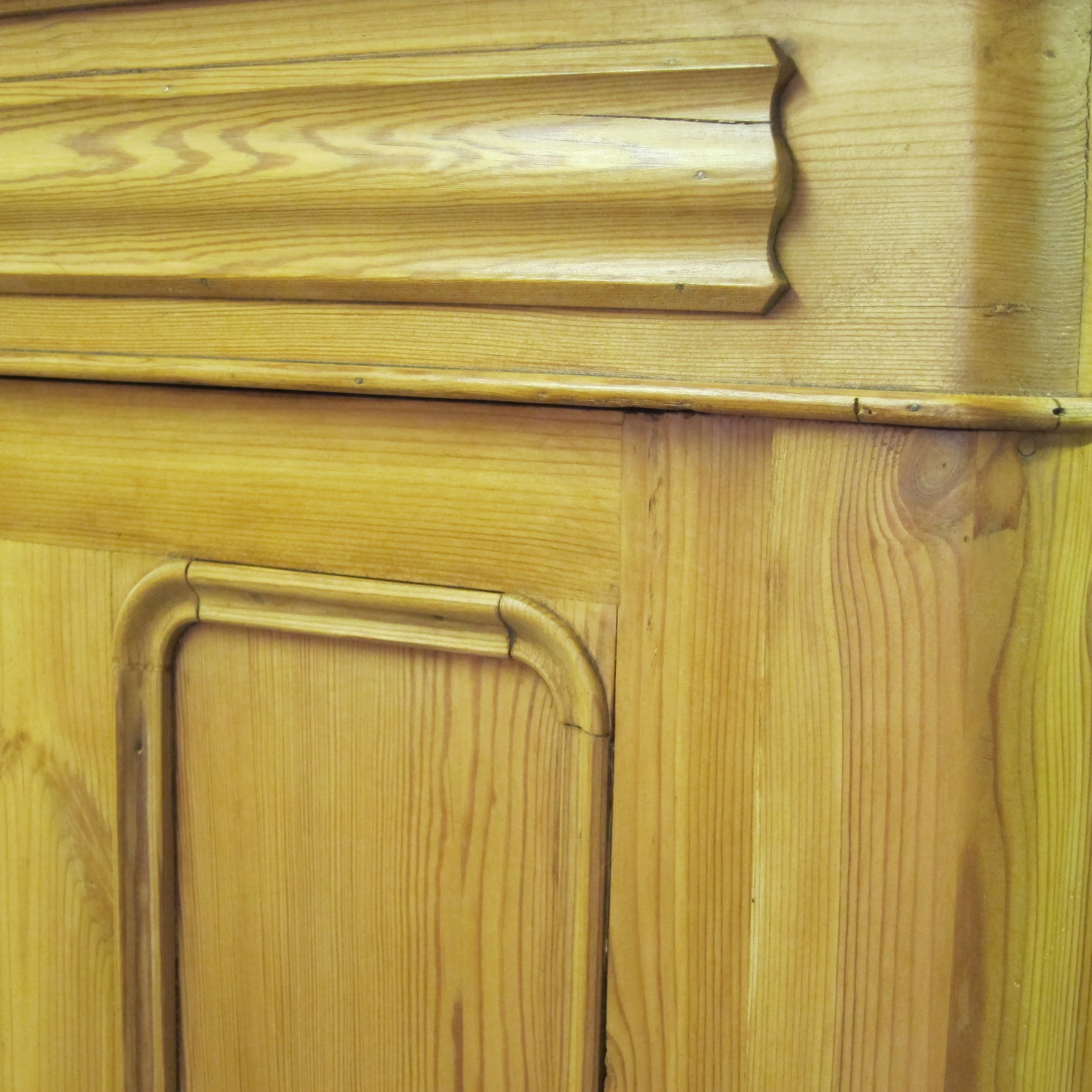 Close up waxed old pine cupboard