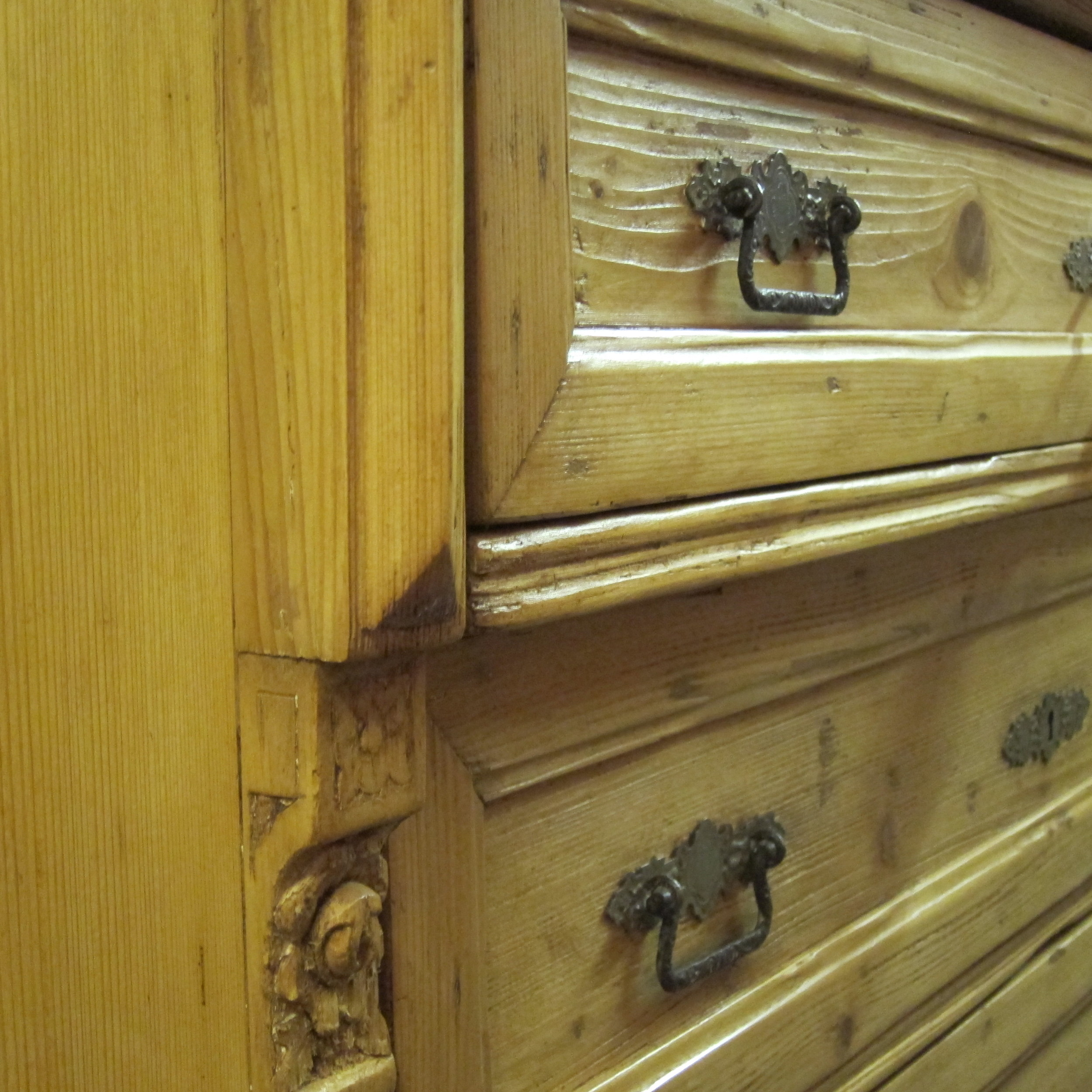 Close up waxed old pine chest of drawers