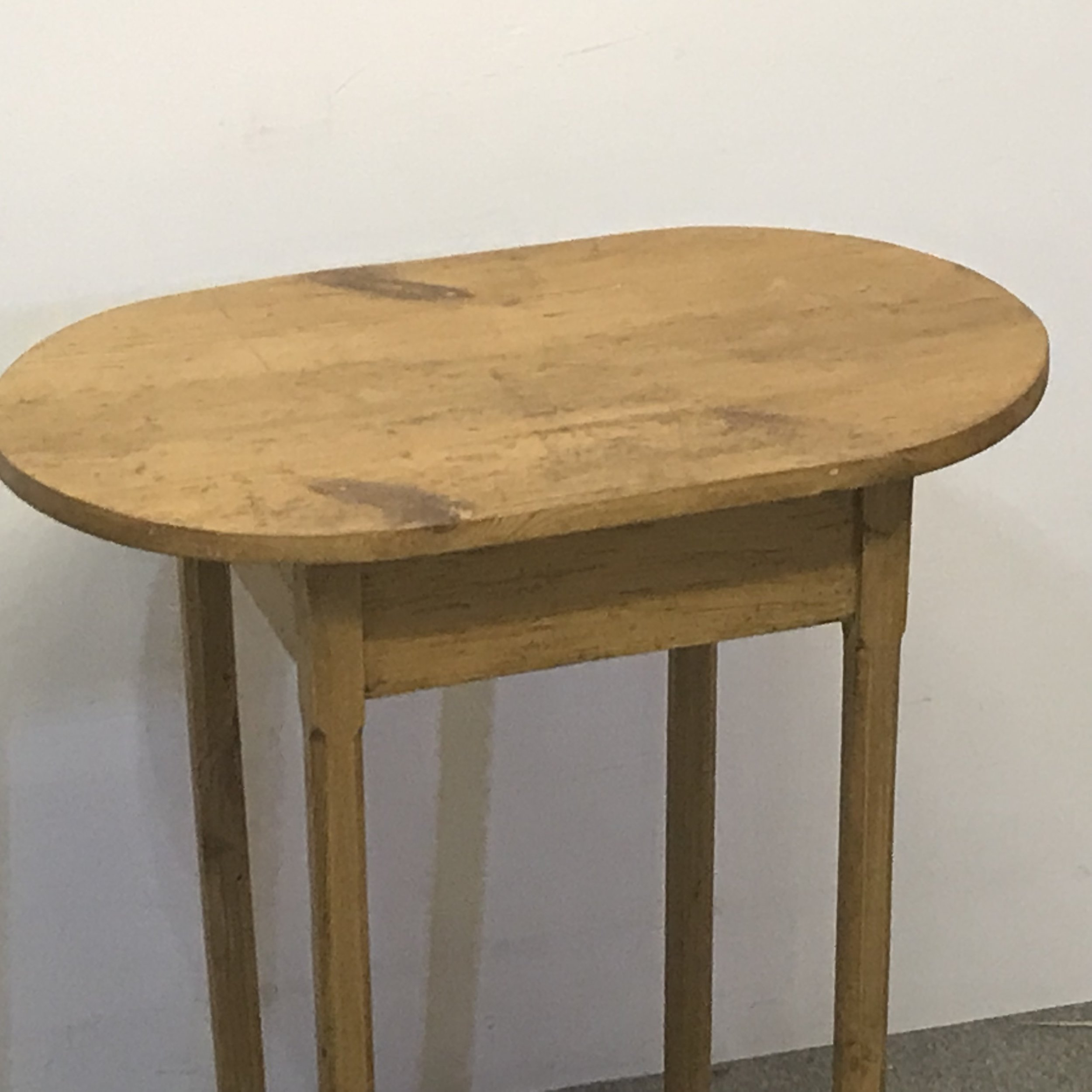 Small oval pine table made from old pine floorboards