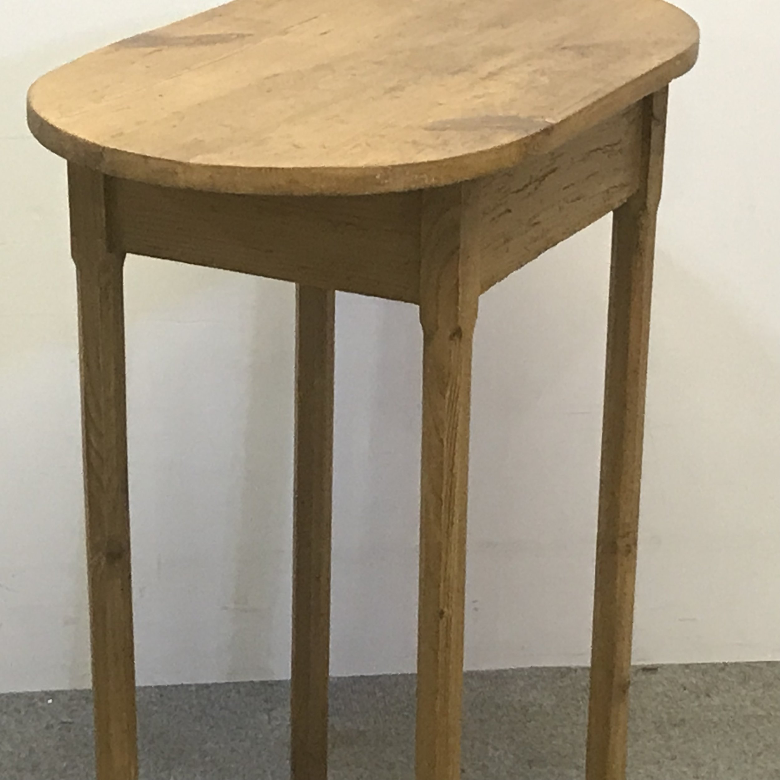 Small oval pine table with slim octagonal legs