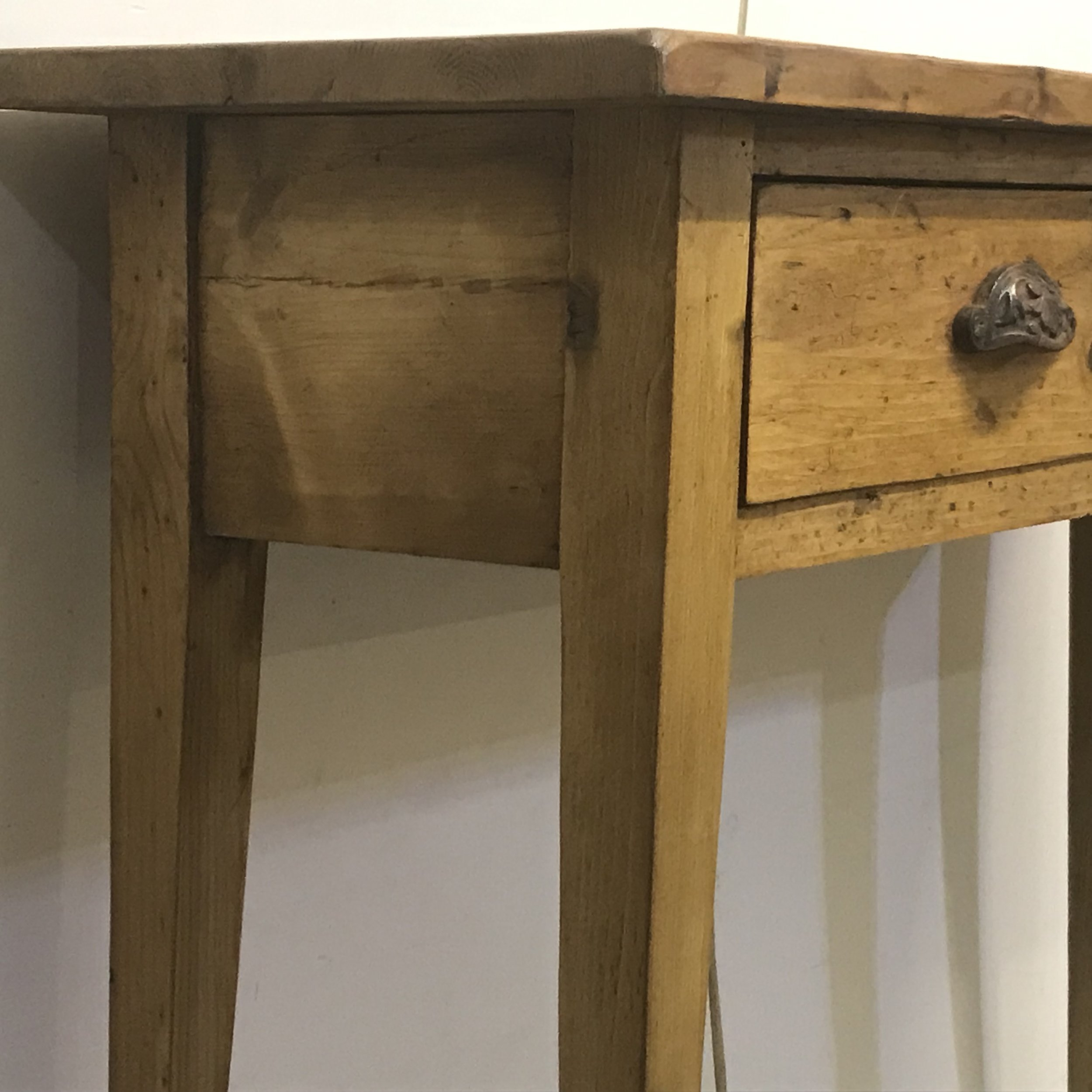 Small pine table with slender tapered legs