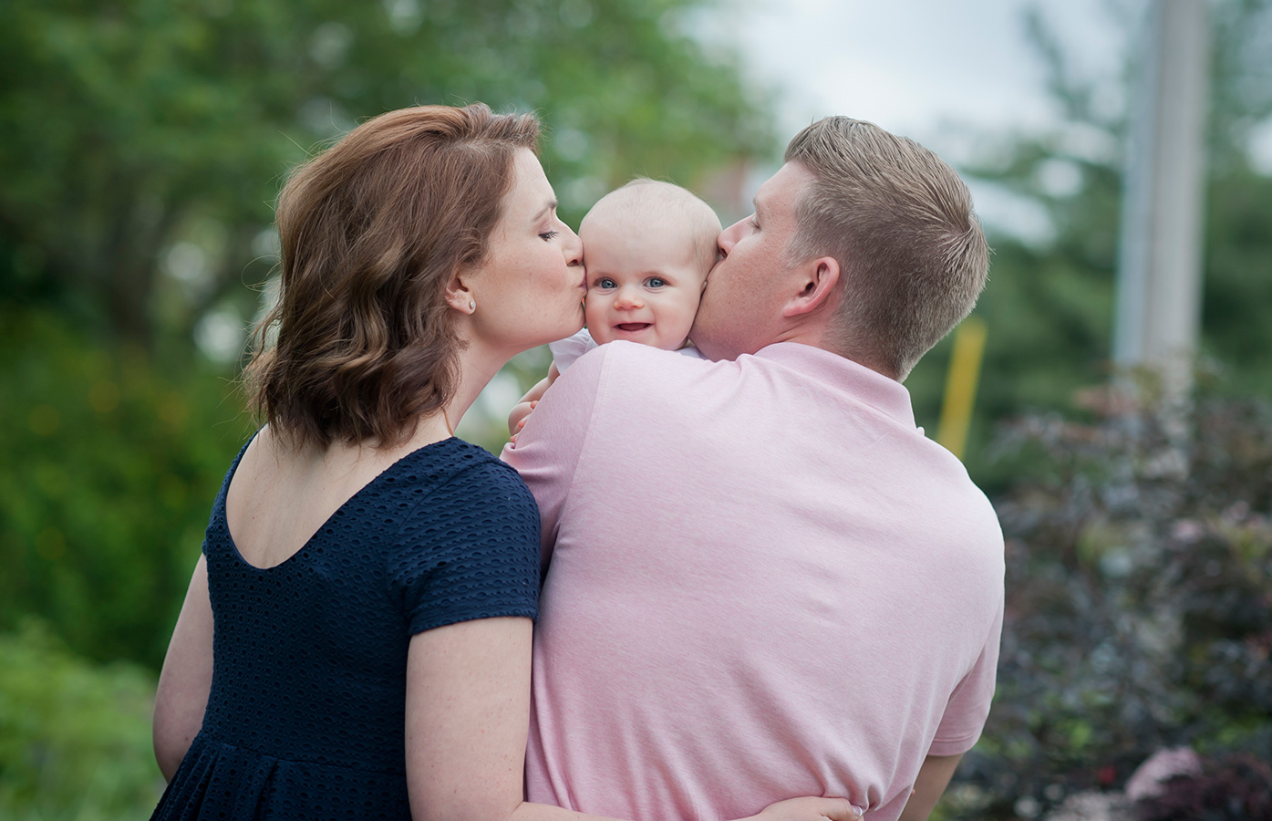 Dr. Randi Green with husband Daniel, and pictured with 6-month-old Callie.  Photography by  Kimberly Ikenroth