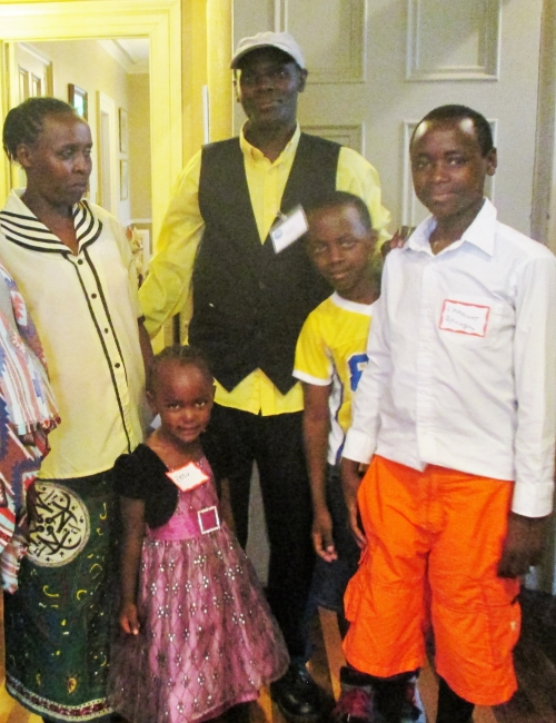 Faustine with his wife and children at Beautiful Day's recent donor appreciation event.