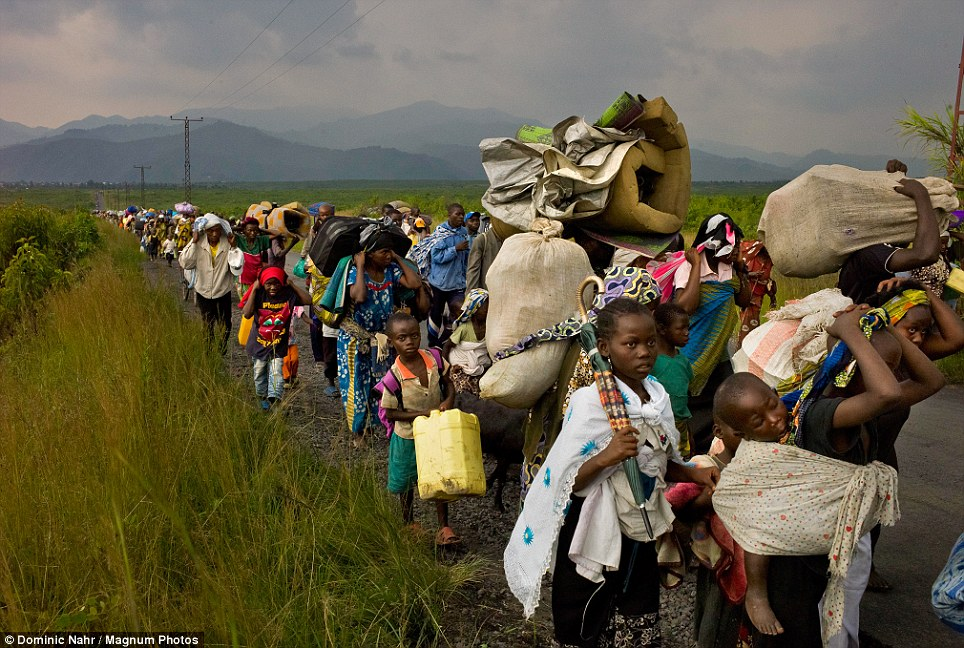 "As of June 2015, there are about 600,000 refugees in Uganda, the largest group, almost 200,000,    from the DRC, Most are ""long-stayers""; they've been in the camp a decade, most 15 years or more.   Fewer than 5,000 Congolese were resettled in the US in 2014."