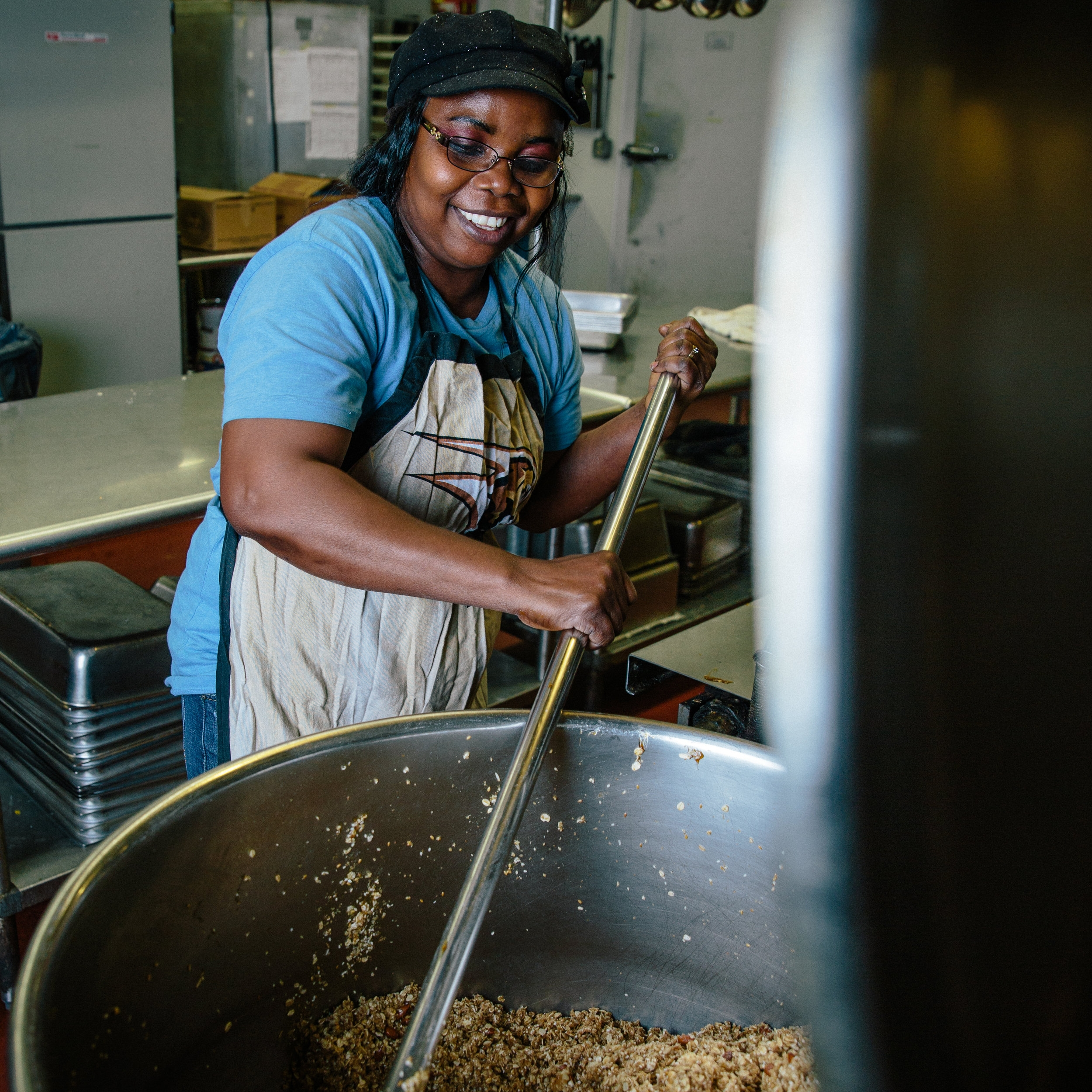 BOLAJoKO, Assistant kitchen manager, TRainer   Bola, originally from Nigeria, joined us as our Servesafe expert, after graduating from the Amos House culinary program. If you'd like to learn how to mix 250 lbs of granola in an evening, she'll be happy to provide a lesson. Just stop by.