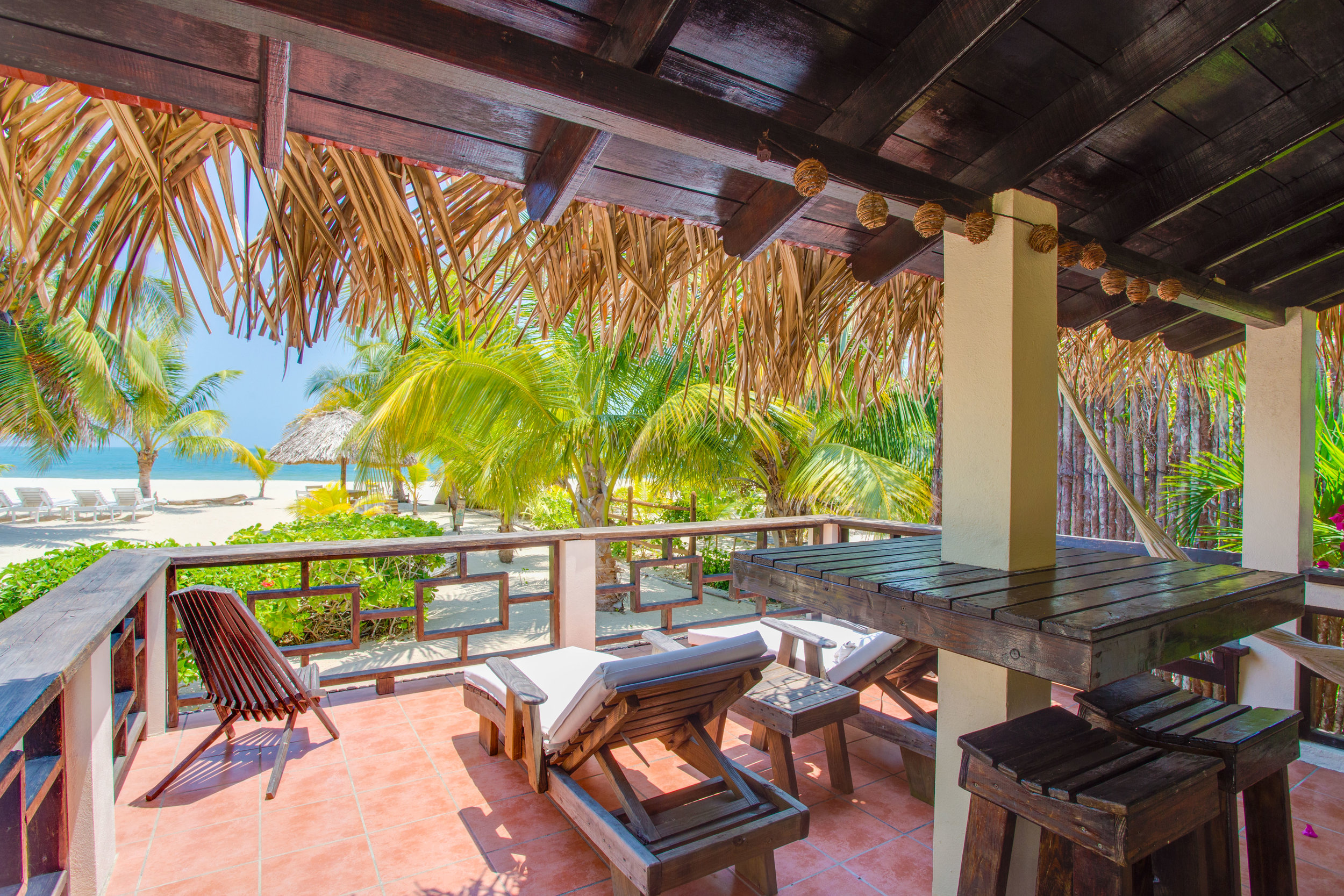 Our extra large verandas seat 8+ - they provide multiple seating options so you can enjoy every activity on your private veranda - cushioned loungers, barstools, bench, clam chairs, and hammock - this is one of many stunning views off Sol veranda