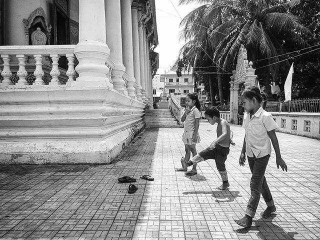 """The time when there are no playstations, iPads, smartphones or any kind of toys, you will invent games like these to keep yourself entertained. I have played this """"shooting slippers"""" game. Have you? #streetphotography #streetkids #streetlife #travelphotography #travel #khmer #khmerkids #cambodia #phnompenh #bnwphotography #bnw #blackandwhitephotography #blackandwhite #documentary #documentaryphotography #kanmanphotography #phonetography"""
