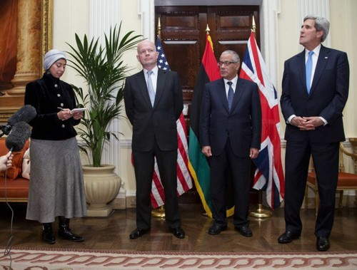 Maha interpreting consecutively during a press conference with former UK Foreign Secretary William Hague, former Libyan PM Ali Zeidan and US Secretary of State John Kerry