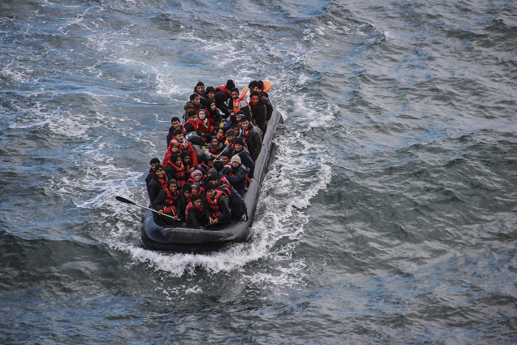 A dinghy carrying refugees from Syria, Iraq and Afghanistan arrives to the shores of Lesvos. October 2015.