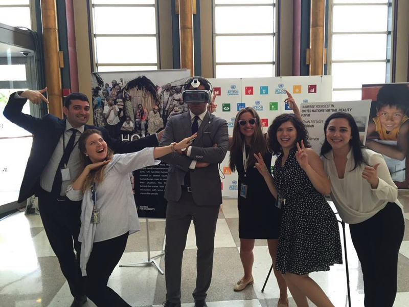 The Secretary-General's Envoy on Youth Ahmad Alhendawi and some members of the team at the virtual reality display on the margins of the 71st Session of the UN General Assembly, September 2016