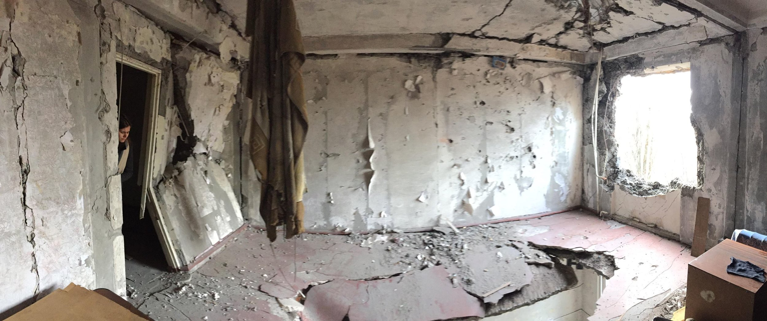 In a heavily damaged apartment building in Donetsk