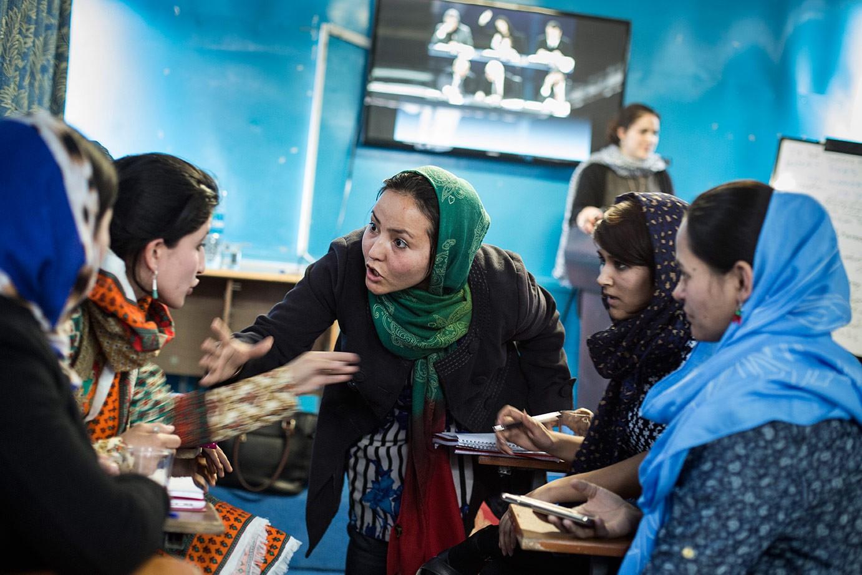 Afghan women receiving journalism training at  Sahar Speaks