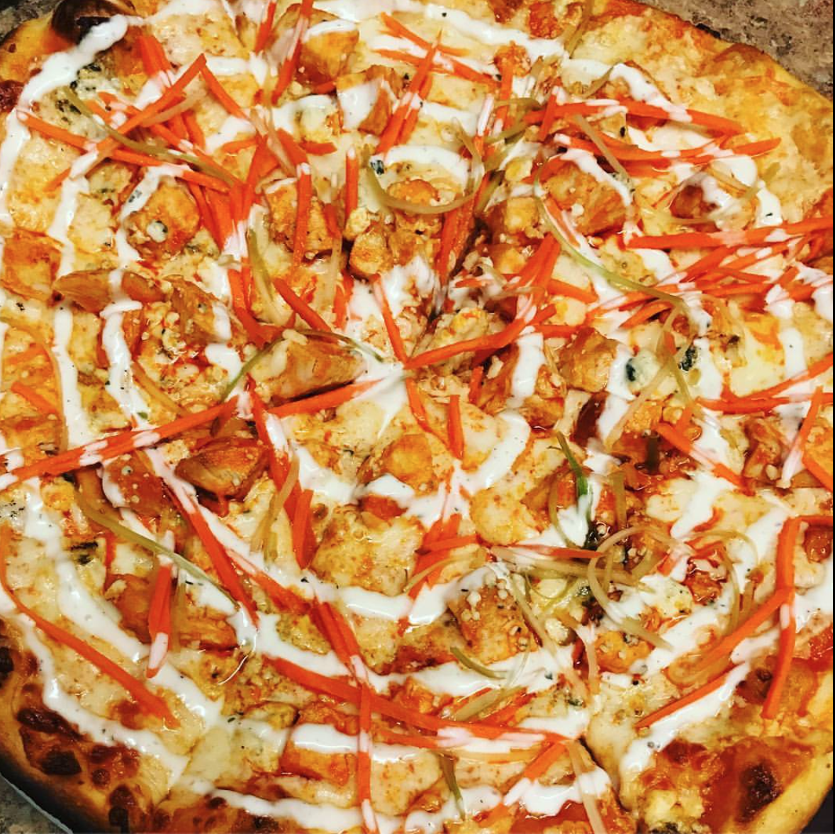 Buffalo Chicken Pizza at State & Allen: Diced Chicken, Shredded Carrots and Celery, Buffalo Sauce, Crumbled Blue Cheese, and a Ranch Drizzle.