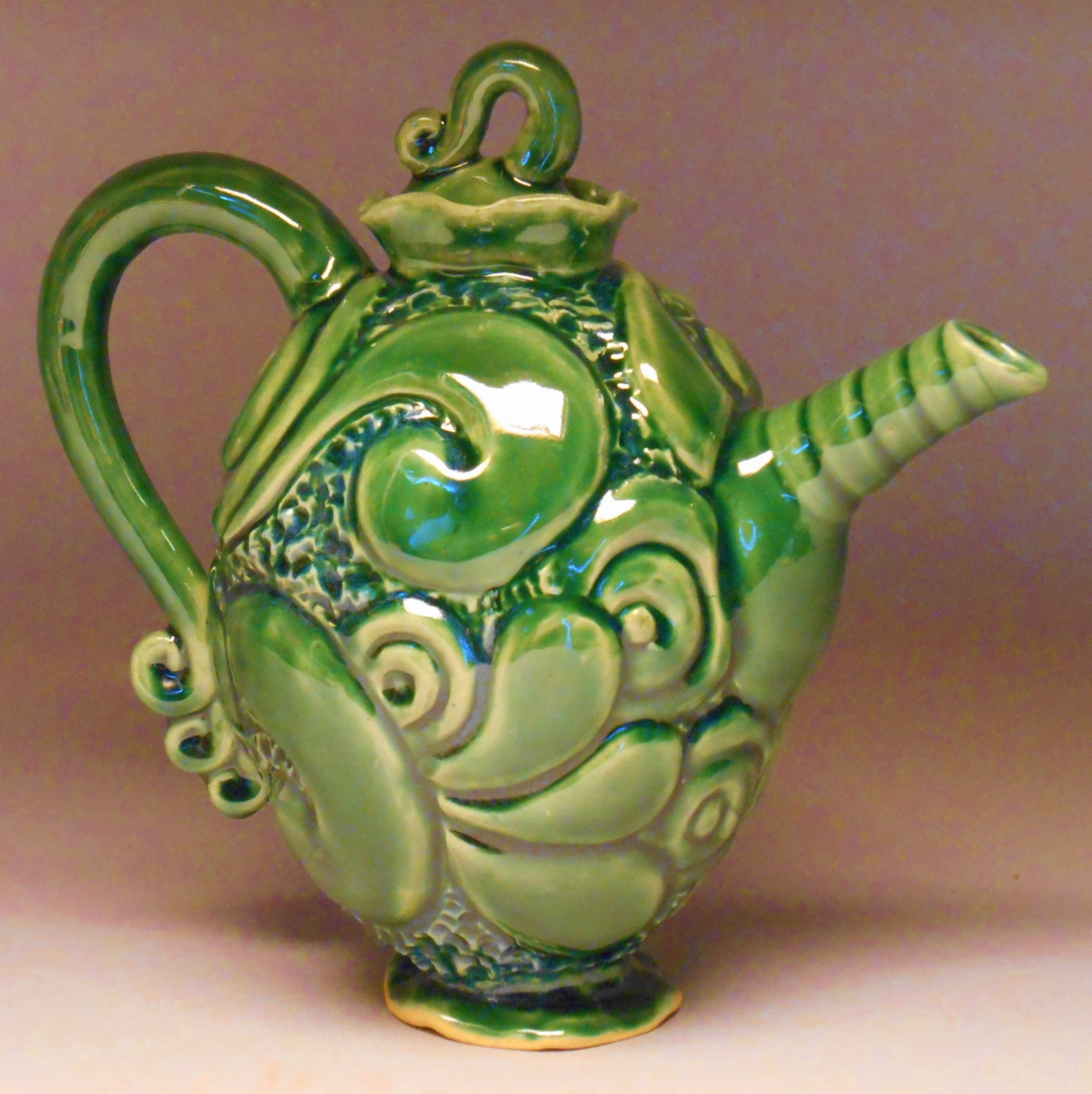 Carved Oval Tea Pot, SOLD