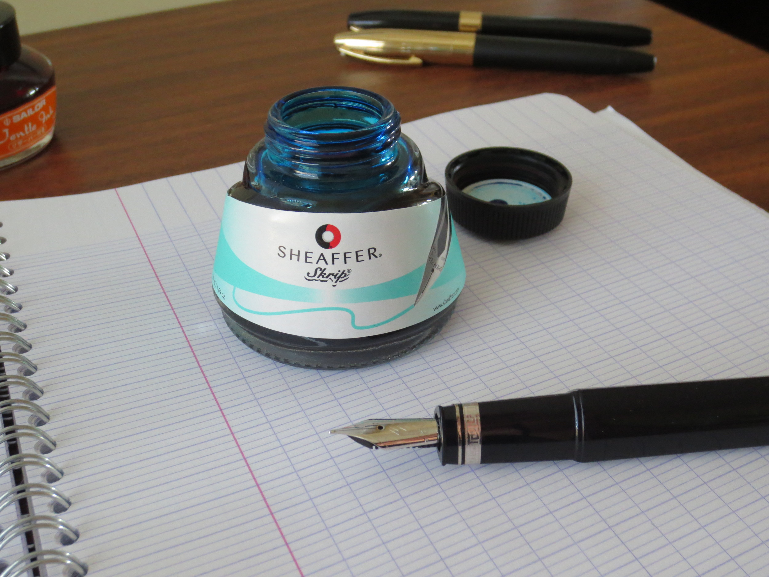 "One major disappointment when Sheaffer revealed their new ""modern"" ink line was that they had done away with their traditional ""inkwell"" bottle in favor of this smaller, triangular bottle that can make it more difficult to get at all of the ink, especially if your pen has a larger nib."