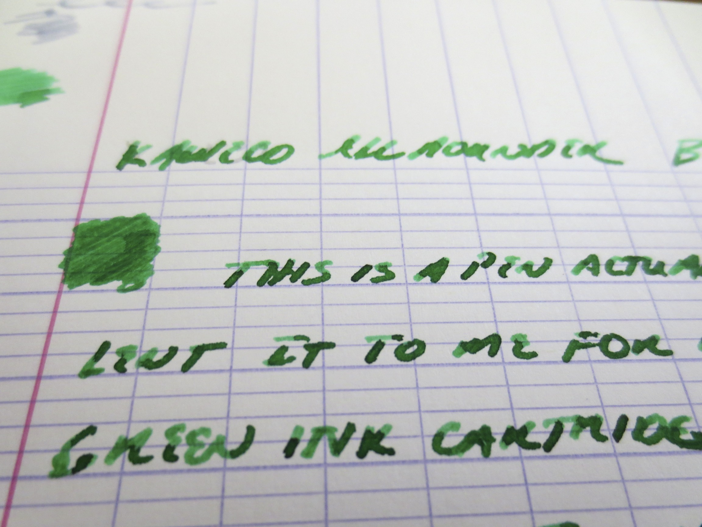 A close-up shot of Kaweco's vibrant Palm Green ink exhibiting gorgeous shading in a double broad nib.