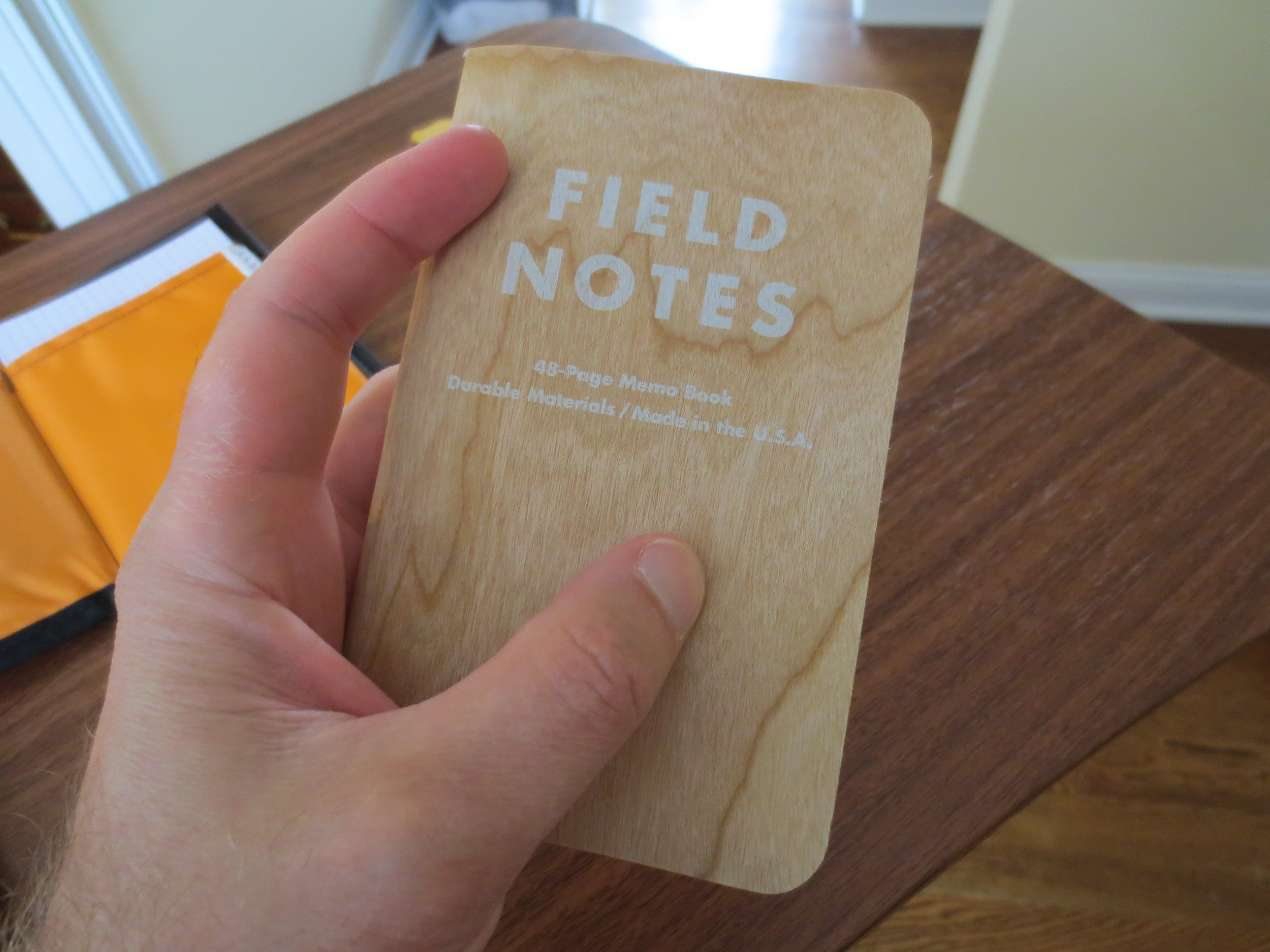 """The wood grain on this particular notebook is gorgeous. The printing on the cover (in """"ghost white"""") ink, looks like whitewash you would see on a wooden fence."""