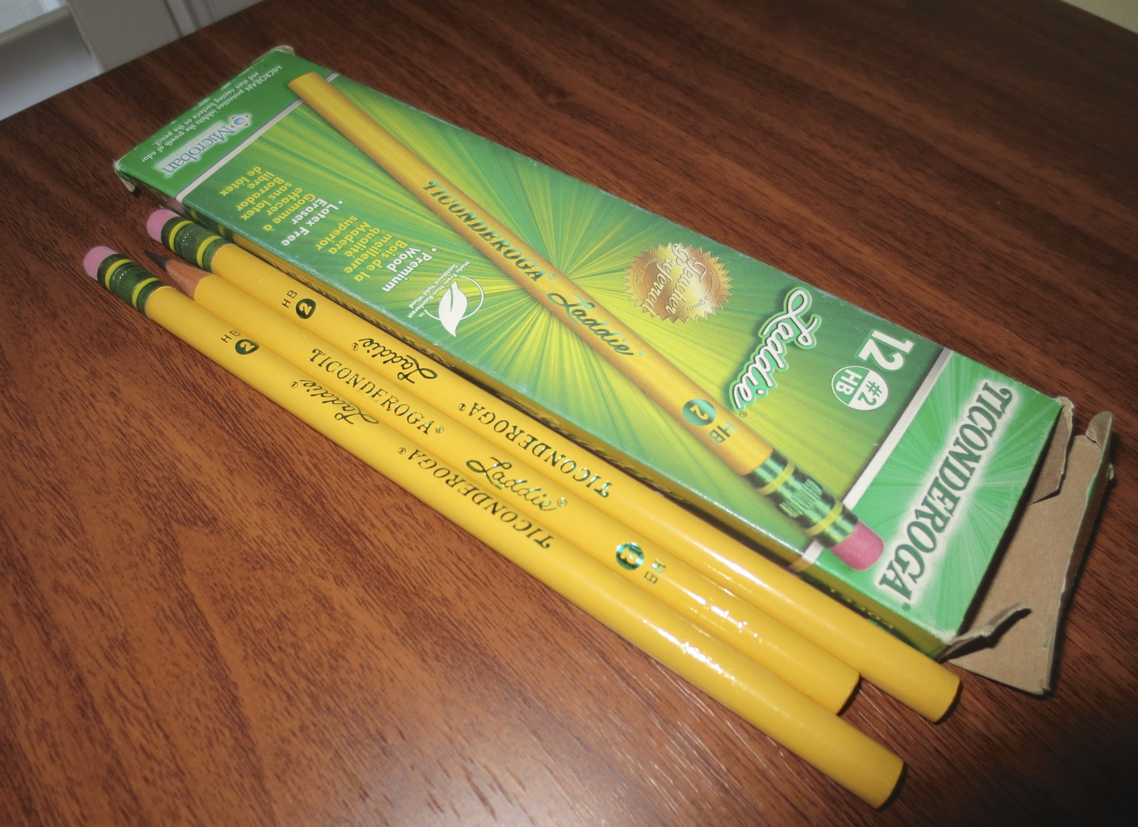 A fresh dozen of Ticonderoga Laddie mini-jumbo pencils with erasers, plus my lone eraserless version.