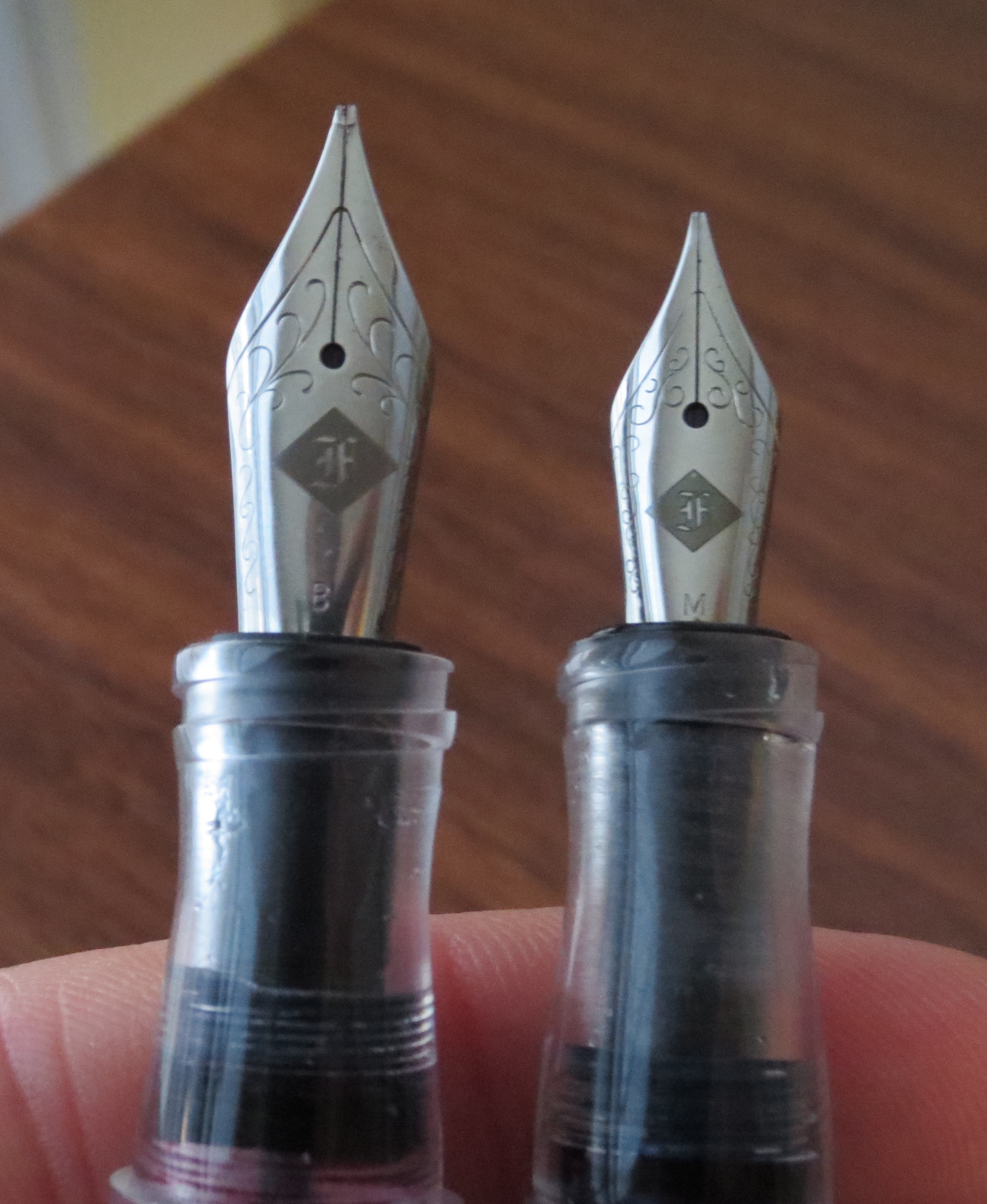 Franklin-Christoph Nib Size Comparison:  Model 66 No. 6 nib on the left; Model 65 No. 5 nib on the right.  Note the threads at the top of the grip section.
