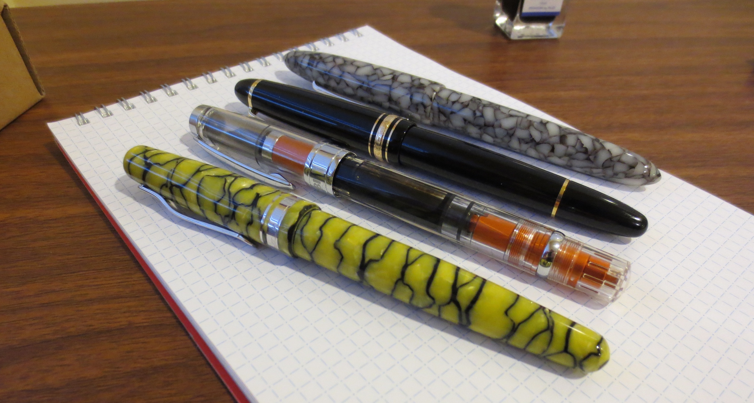 A comparison of the TWSBI 580 agains some similarly sized pens in my collection:  from bottom, the Delta Fusion 82, the TWSBI 580 AL, the Montblanc 146, and the Edison Herald.