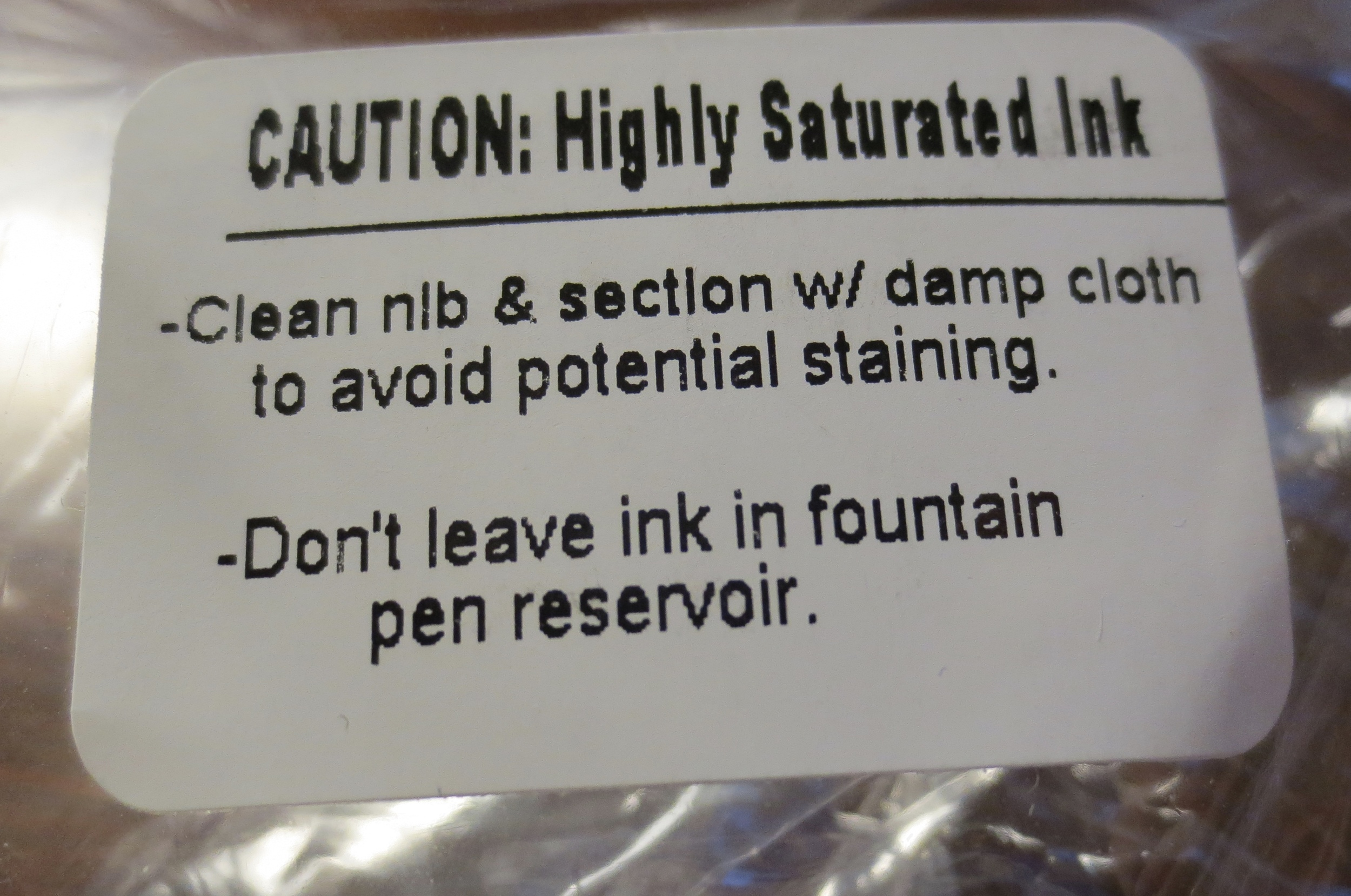 I would agree that you should heed the warning on the box.  (It has everything but the skull and crossbones.)  A cartridge-converter pen might give you more leeway, but I'd flush pens filled with this ink at least every couple of weeks or so.
