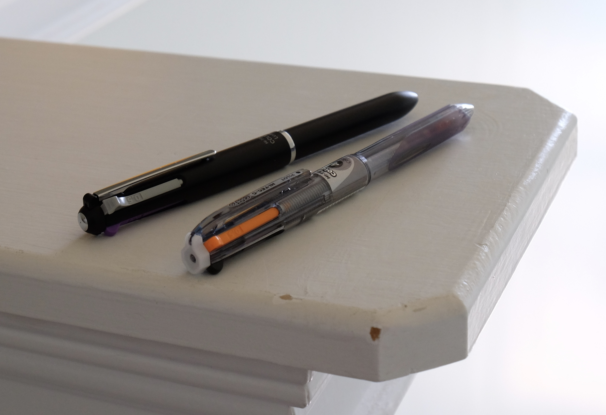 The Pilot Hi-Tec-C Coleto is my favorite multi pen. The top pen is the Coleto Lumio, a slightly higher-end body, and the bottom pen is the standard Coleto, which typically costs around $3.