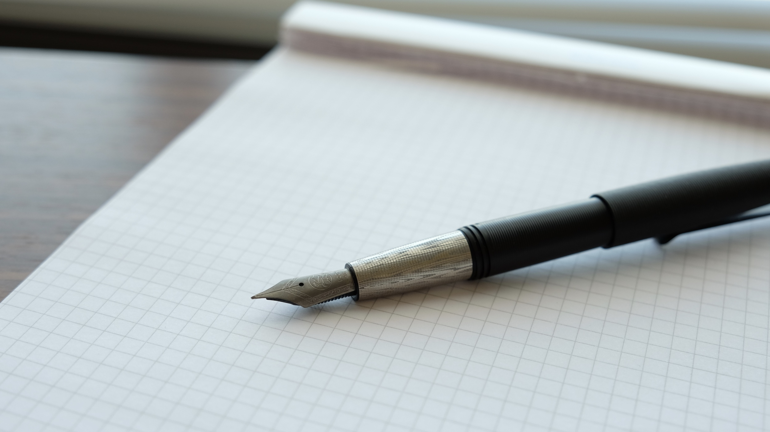 The Tactile Turn Gist Fountain Pen in polycarbonate with Damascus grip and finial. Bock titanium nib.