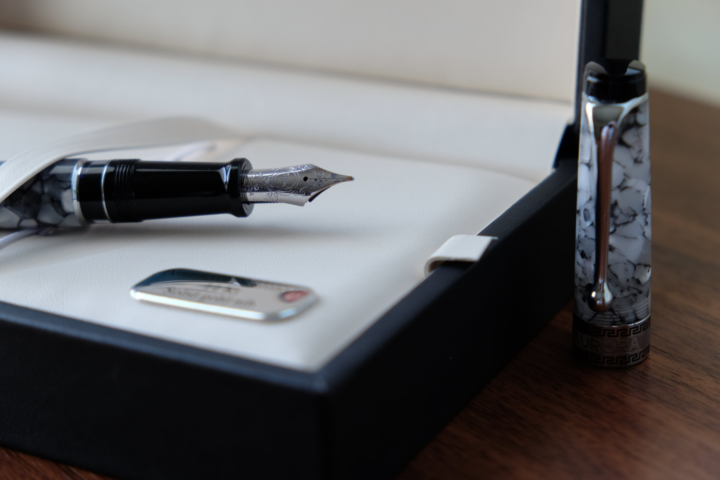 The Aurora Optima features a 18k nib. This one started life as a medium but has been ground to a cursive italic.