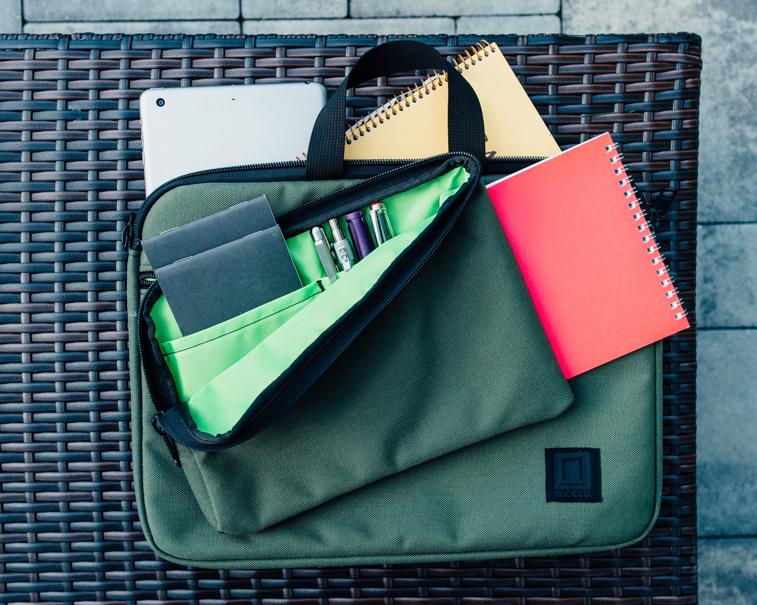 The Nock Co. Lanier minimal briefcase in the olive and lime green colorway.