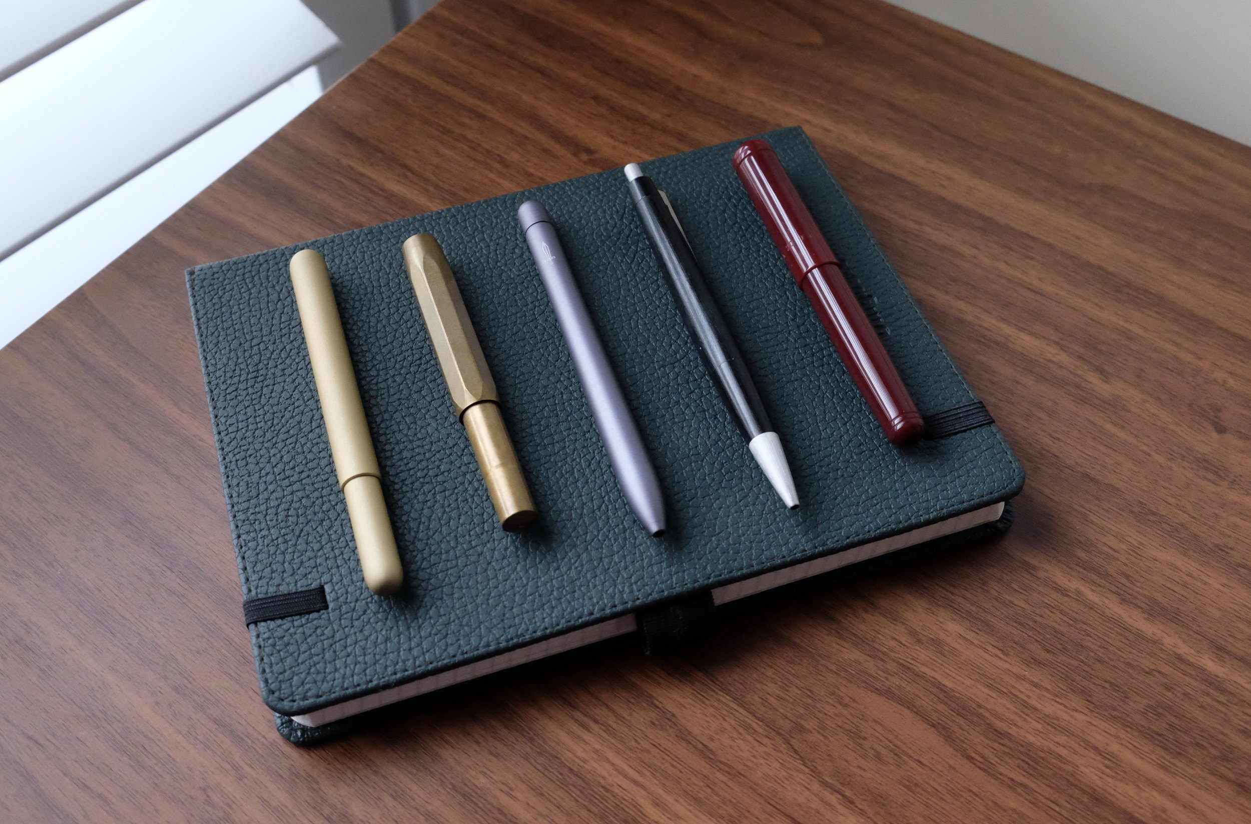 From left, a visual comparison of the Steel and Flint pen to the  Kaweco Brass Sport , the  Baron Fig Squire ,  the Lamy 2000 ballpoint , and  the Franklin-Christoph Pocket 20 .