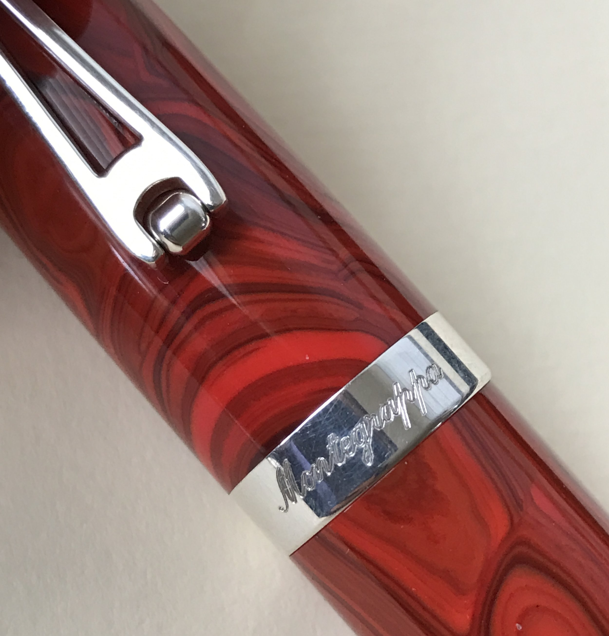 A close-up of the Passione Cinnamon celluloid, with Montegrappa's roller-clip and engraved cap band.
