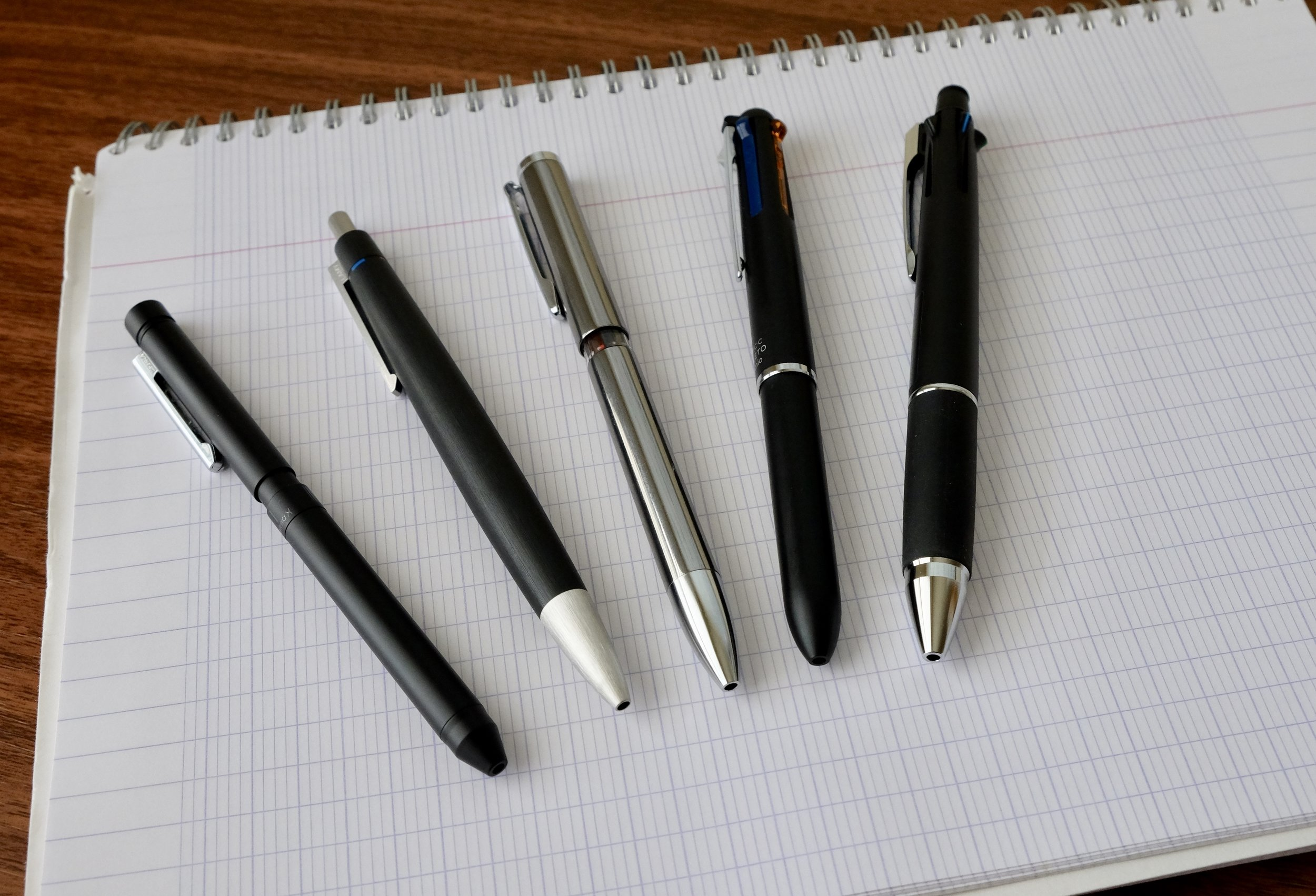 "I went on a bit of a multi pen binge these past few months.  You know, ""for science."" From left, the Zebra Sharbo X, Lamy 2000 4-Color Ballpoint, Uni Style Fit, Pilot Hi-Tec-C Coleto, and Uniball Jetstream."