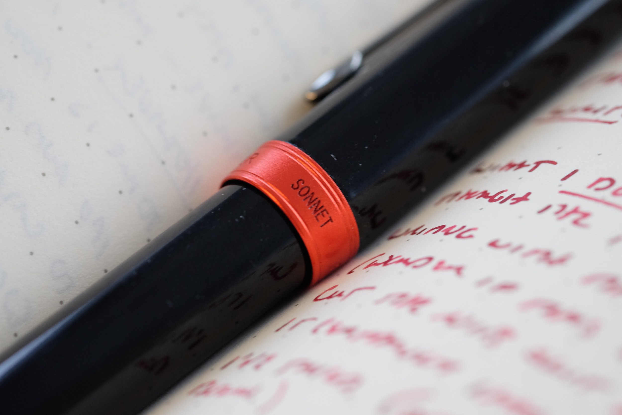 The red brushed metal cap band is my favorite aspect of this pen. It's a simple design, but the pen really pops.