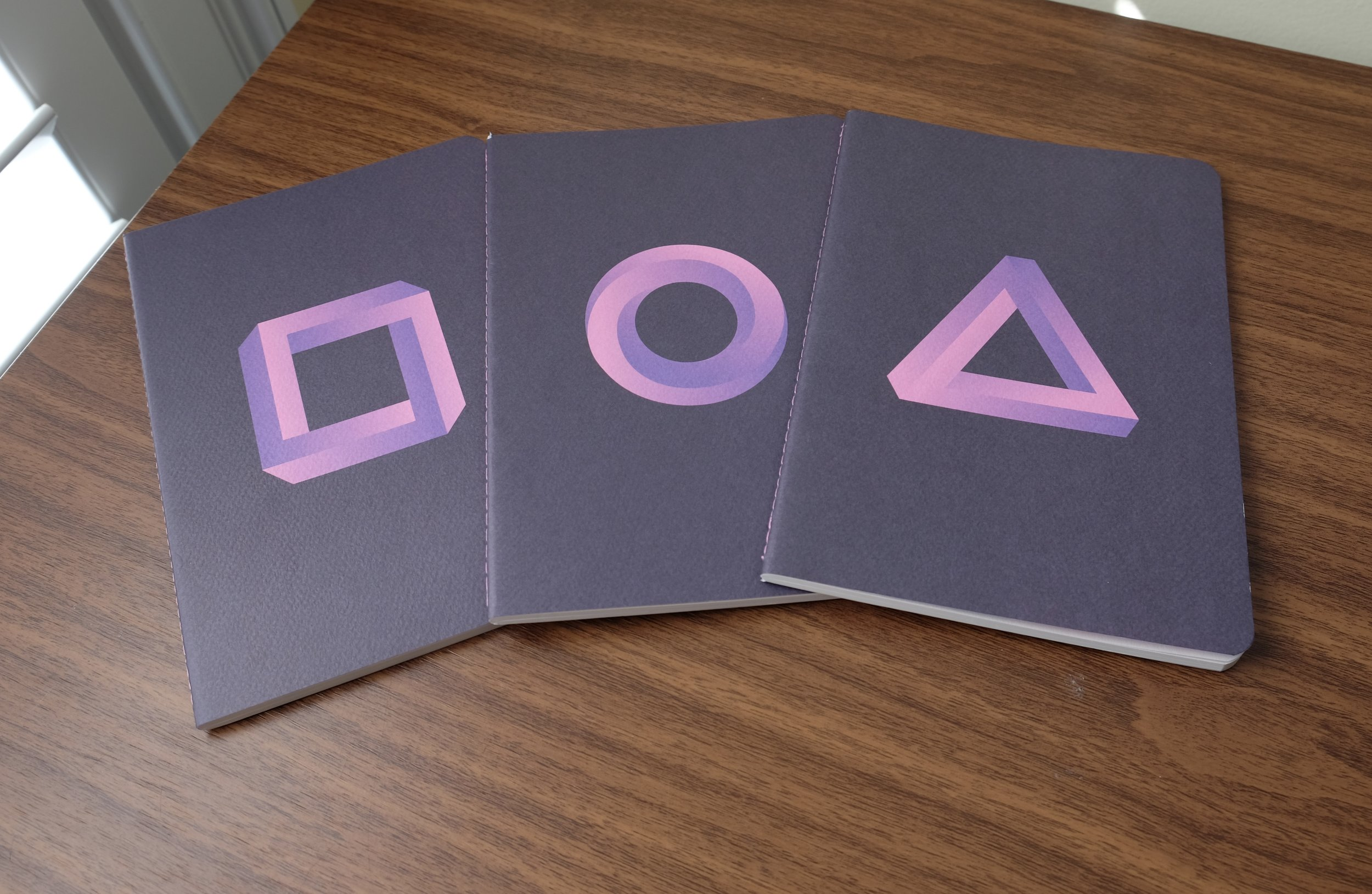 "The three ""infinity"" shapes, out of the shrink wrap."