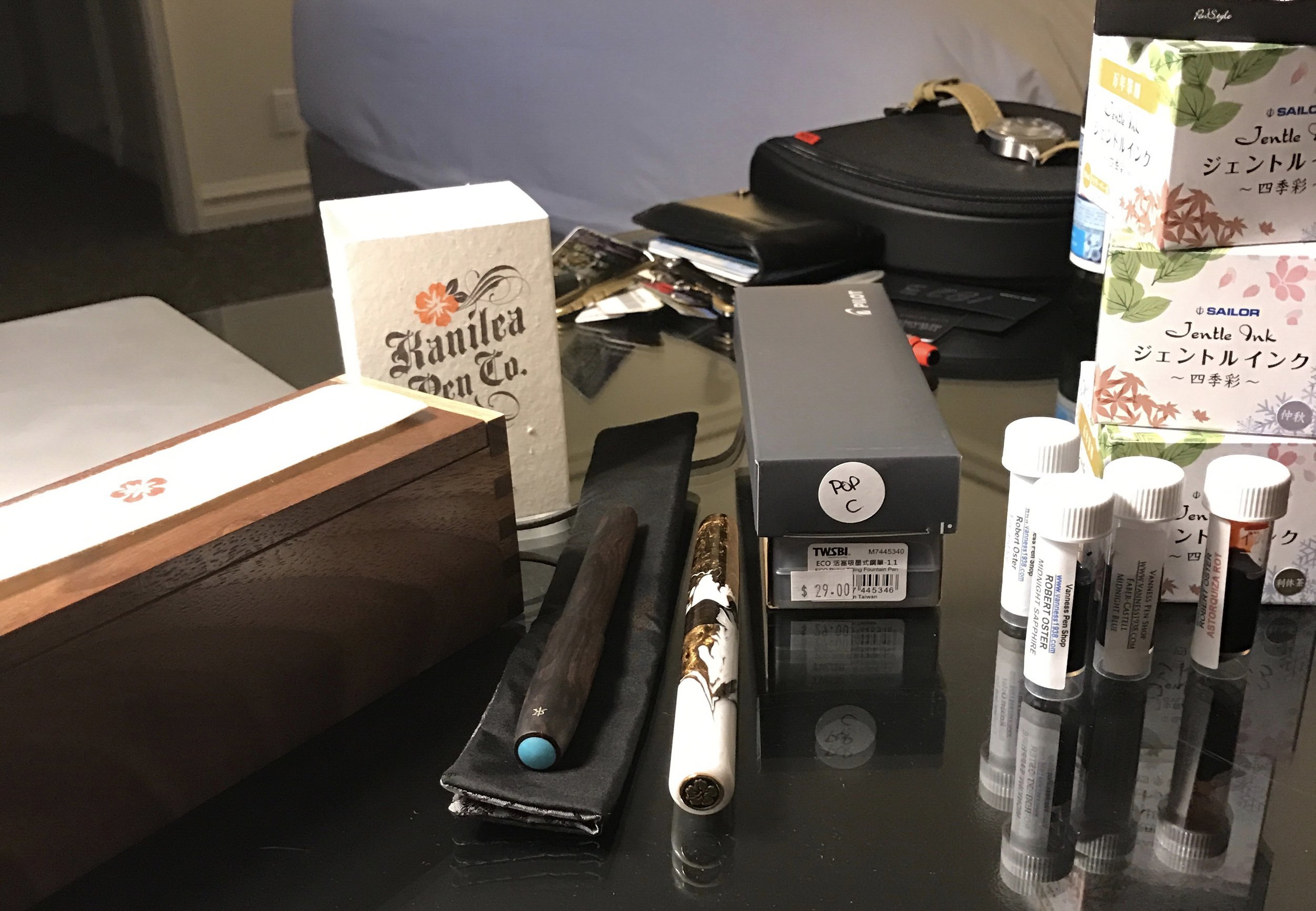 Pens and Ink I purchased on Friday in Baltimore:  Ryan Krusac Legend in Cocobolo with Turquoise Inlay ,  Kanilea Pen Company Mauna Kea ,  Pilot Metropolitan/MR in Gray with Stub Nib ,  Clear TWSBI Eco with Stub Nib , some  Robert Oster Ink Samples from Vanness Pens , and some  Sailor Inks (Chu Shu, Rikyu Cha, and Waka Uguisu) from Anderson Pens .