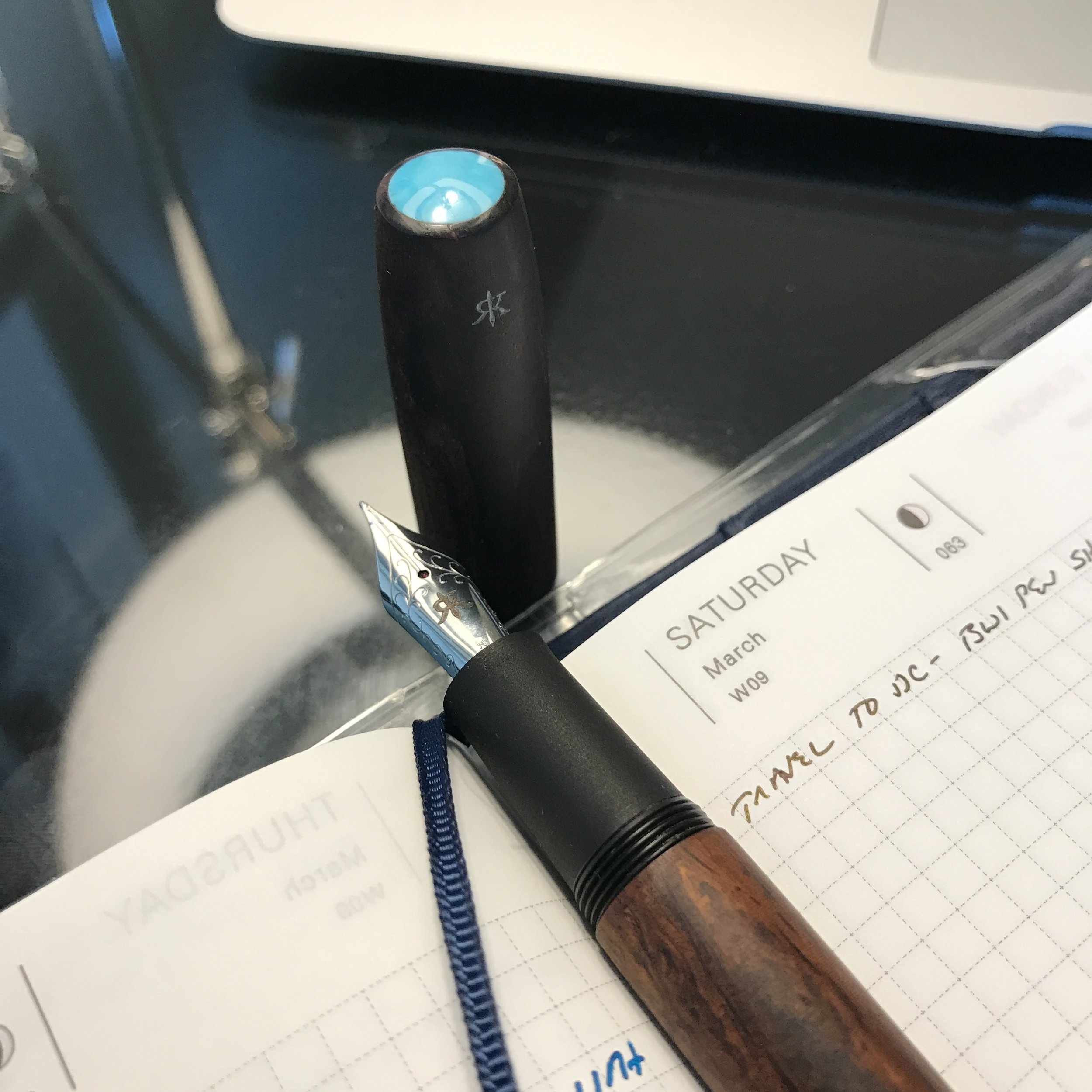 My Ryan Krusac  Legend Pen in Cocobolo with a Turquoise Inlay and Ebonite Section . I've been eyeing one of these pens for a long time - look for a review up on the blog in the future.