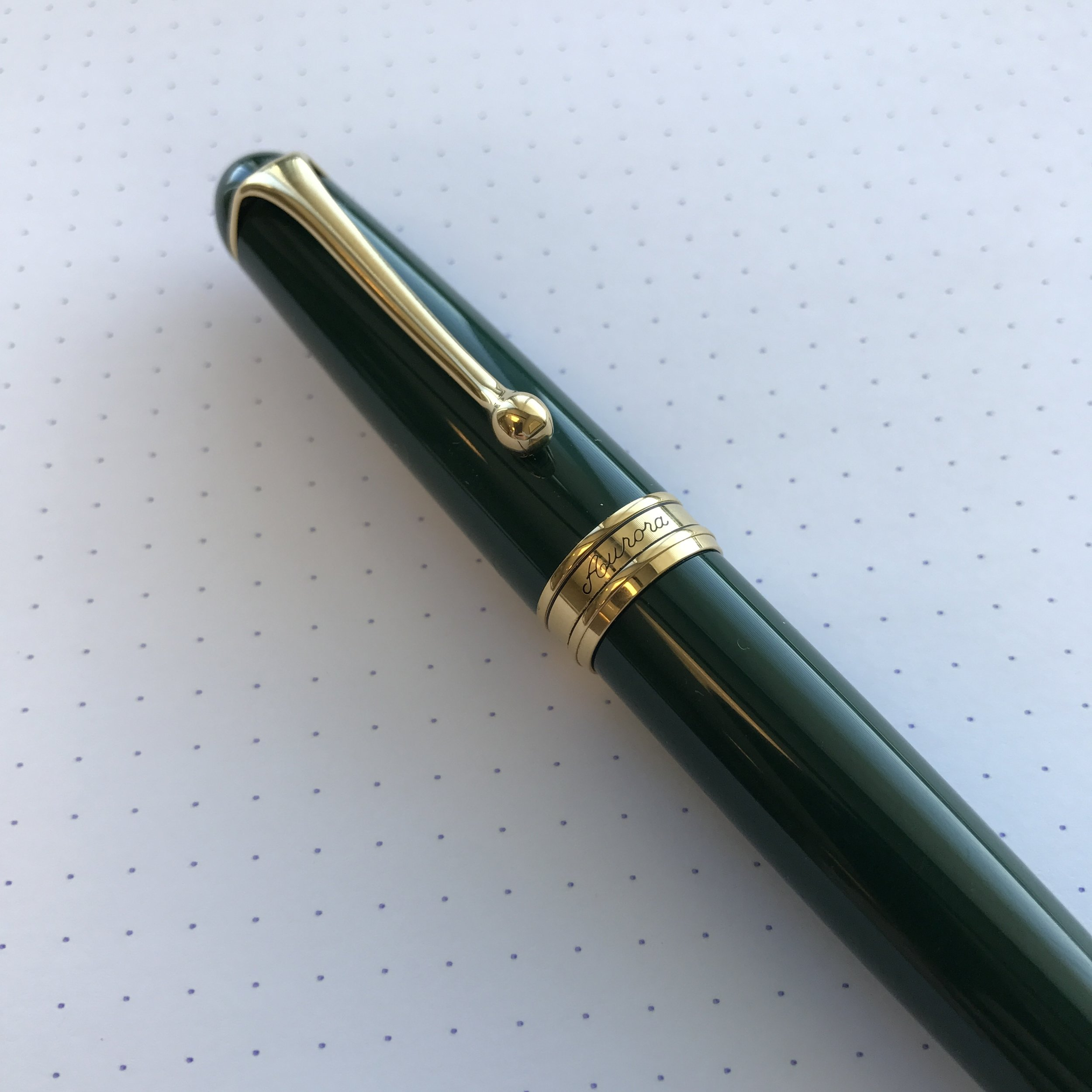 The Aurora 88 is a classic fountain pen. The version that I have is made from a dark green polished resin with gold trim.
