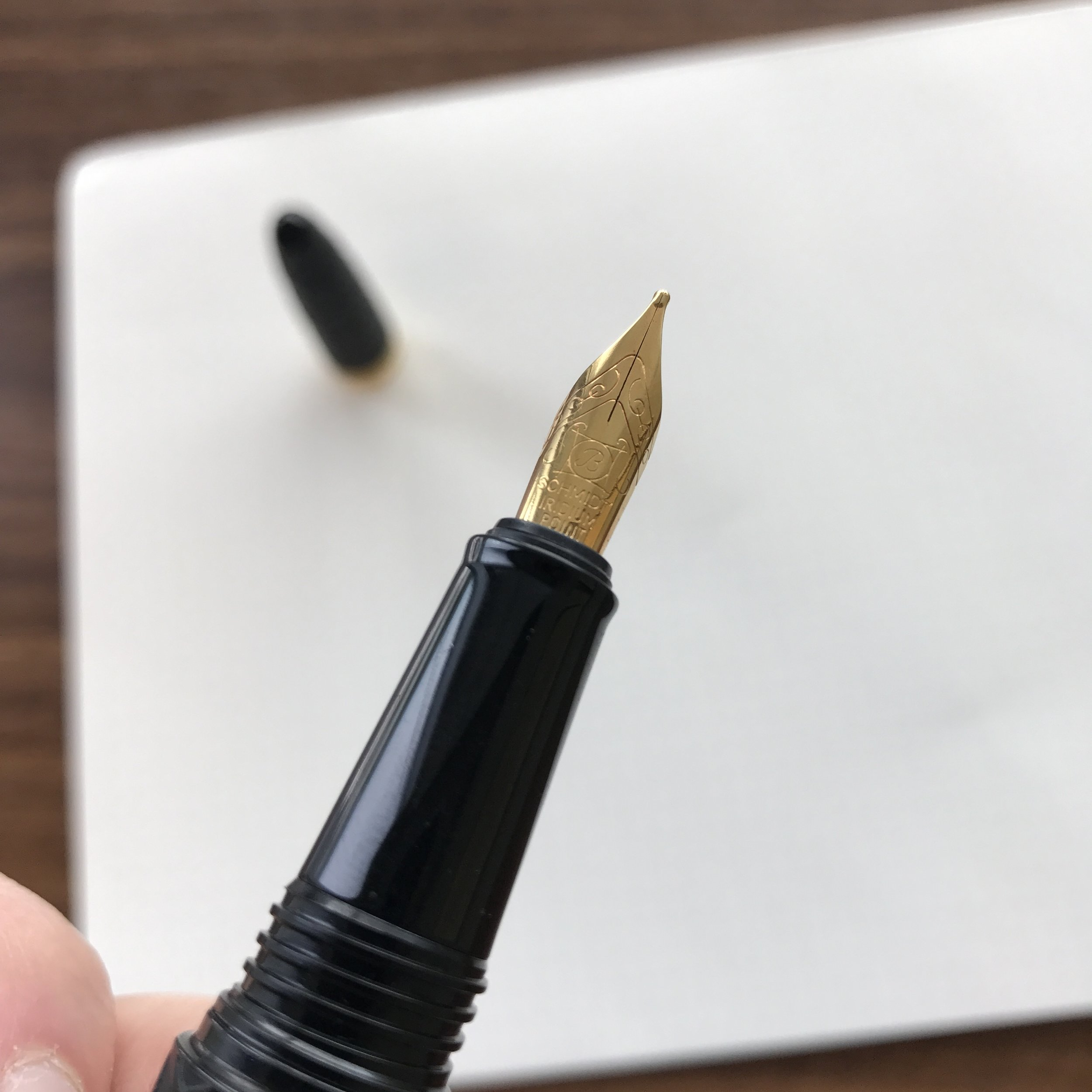 A shot of the broad, gold-plated Schmidt nib on the Benu Skull pen. Check out the almost stubbish shape of the nib!