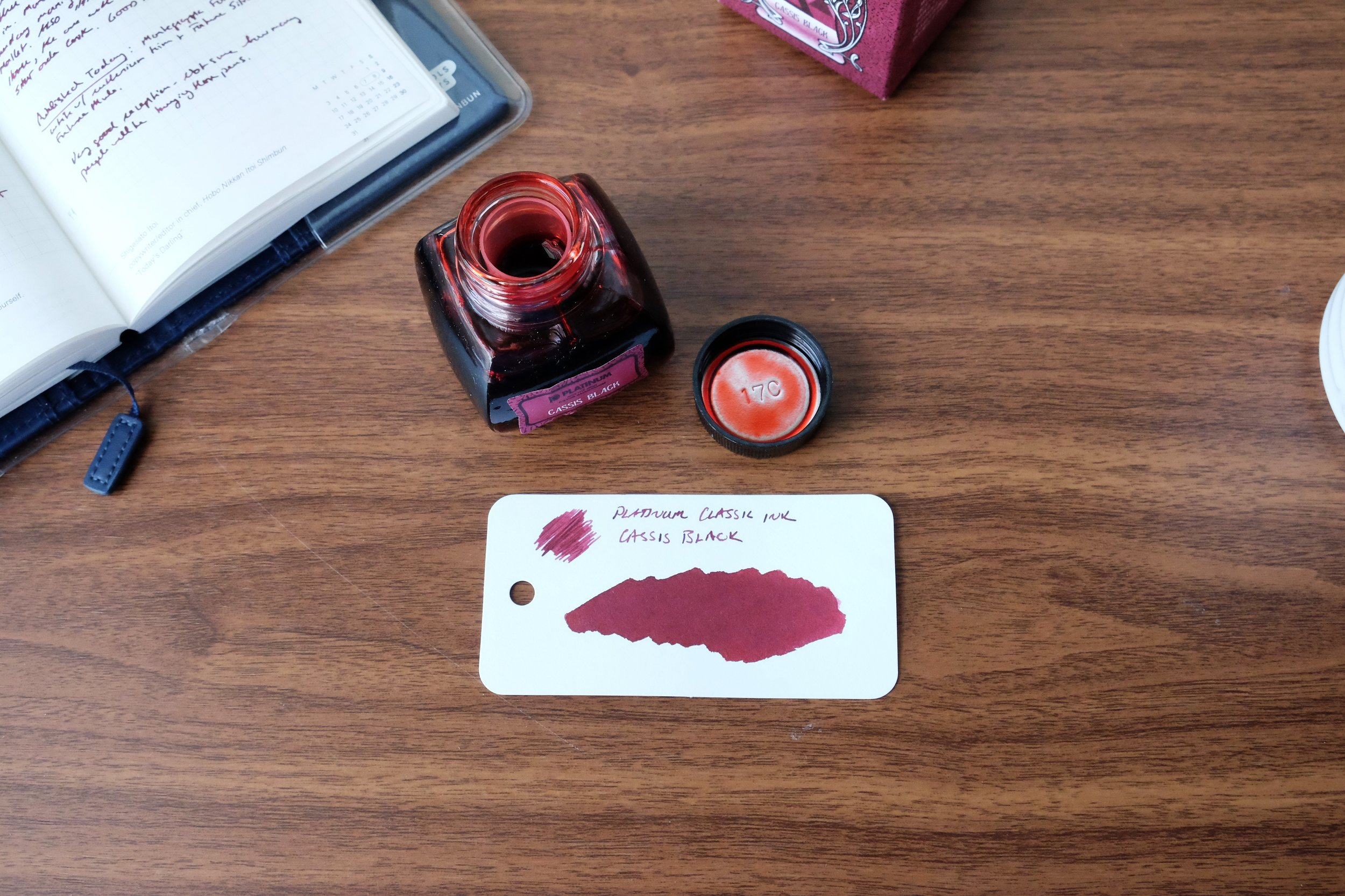 You can get a sense of the color change here: compare the cherry-red wet ink on the inside of the cap to the dried writing sample/swab (on  Col-o-Ring Paper ).