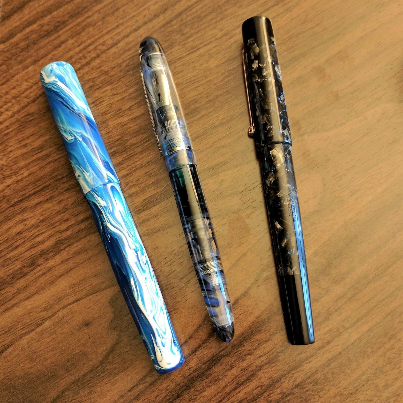 From left: Kanilea Pen Co Nui Nalu, Edison Menlo with Draw Filler in blue flecked acrylic, and Edison Glenmont in Tibaldi Impero Celluloid.