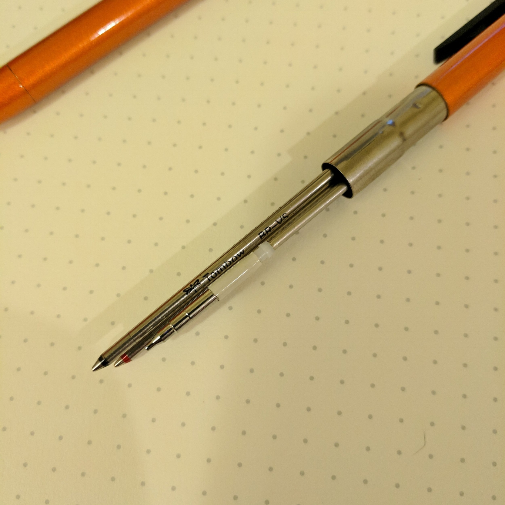 Pull off the bottom part of the barrel to expose the refills. D1 refills are universal, so any pen that accepts them is exceptionally versatile.