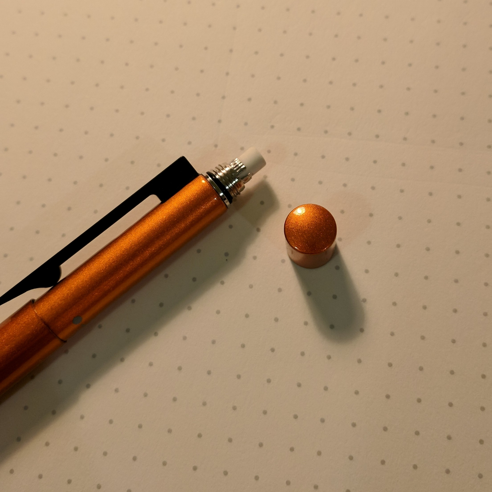 And, like many multi pens, you unscrew the end cap to expose the eraser. You can also get a glimpse of the shimmer on the metallic finish here.