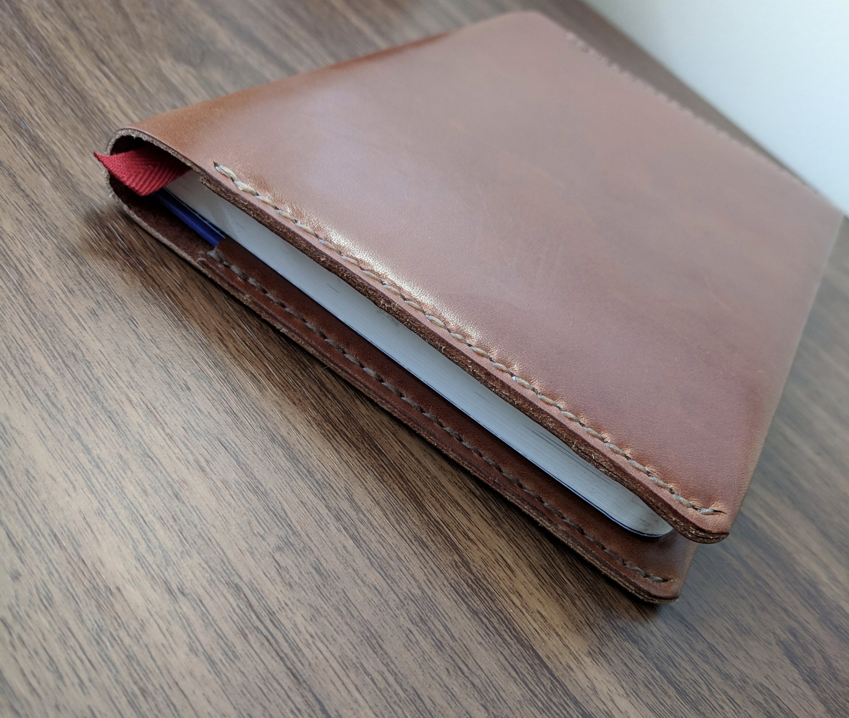 "The hand stitching on my Confidant cover is pretty much flawless. Also, the leather is soft to the touch while still feeling sturdy, if that makes sense. None of that ""plasticky"" feel that you sometimes get with cheaper notebook covers."