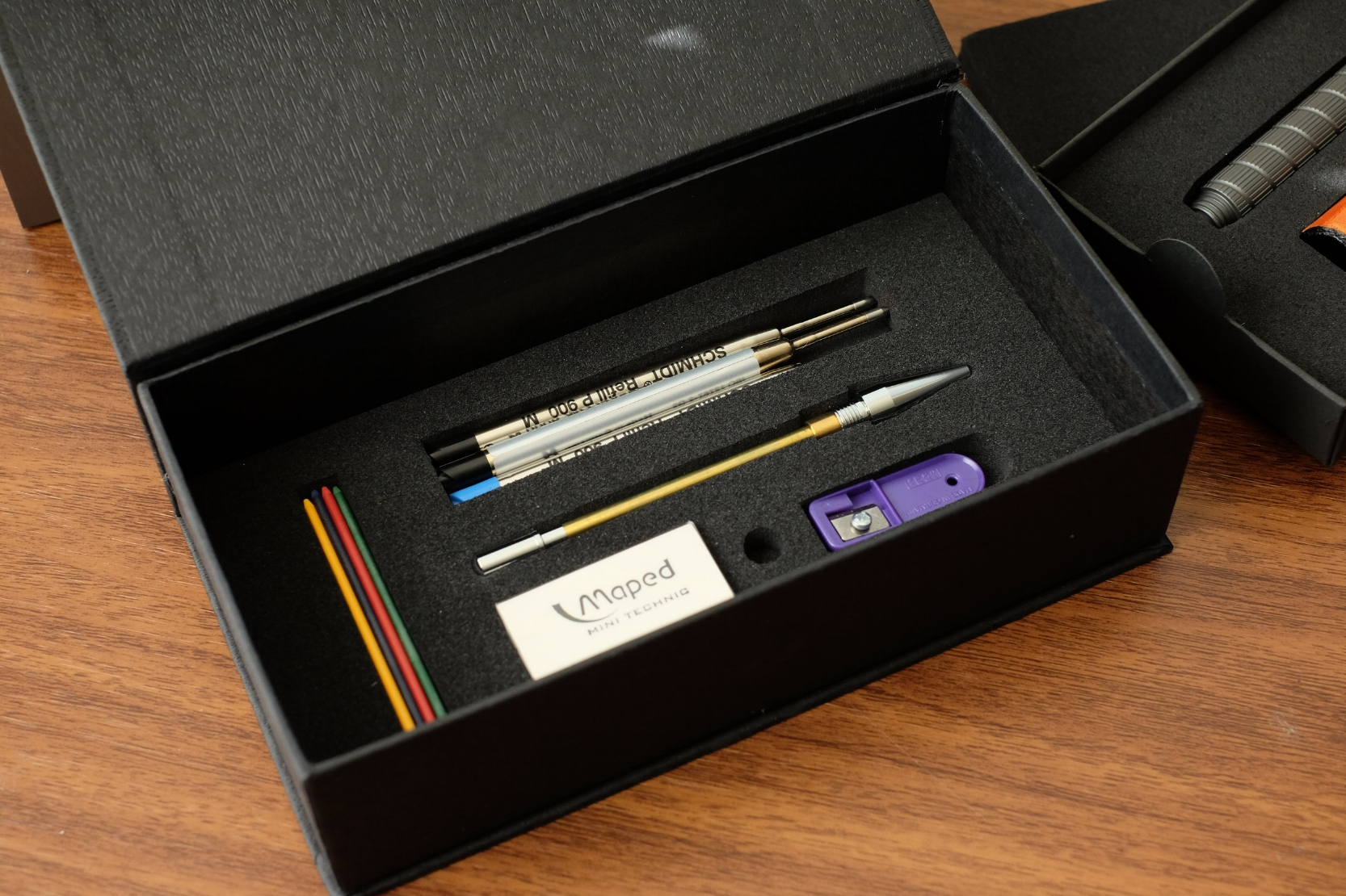"Under the ""false bottom"" of the box, you'll find three additional Schmidt Easyflow Refills, the clutch pencil insert with multicolor leads, a lead pointer, and an eraser."