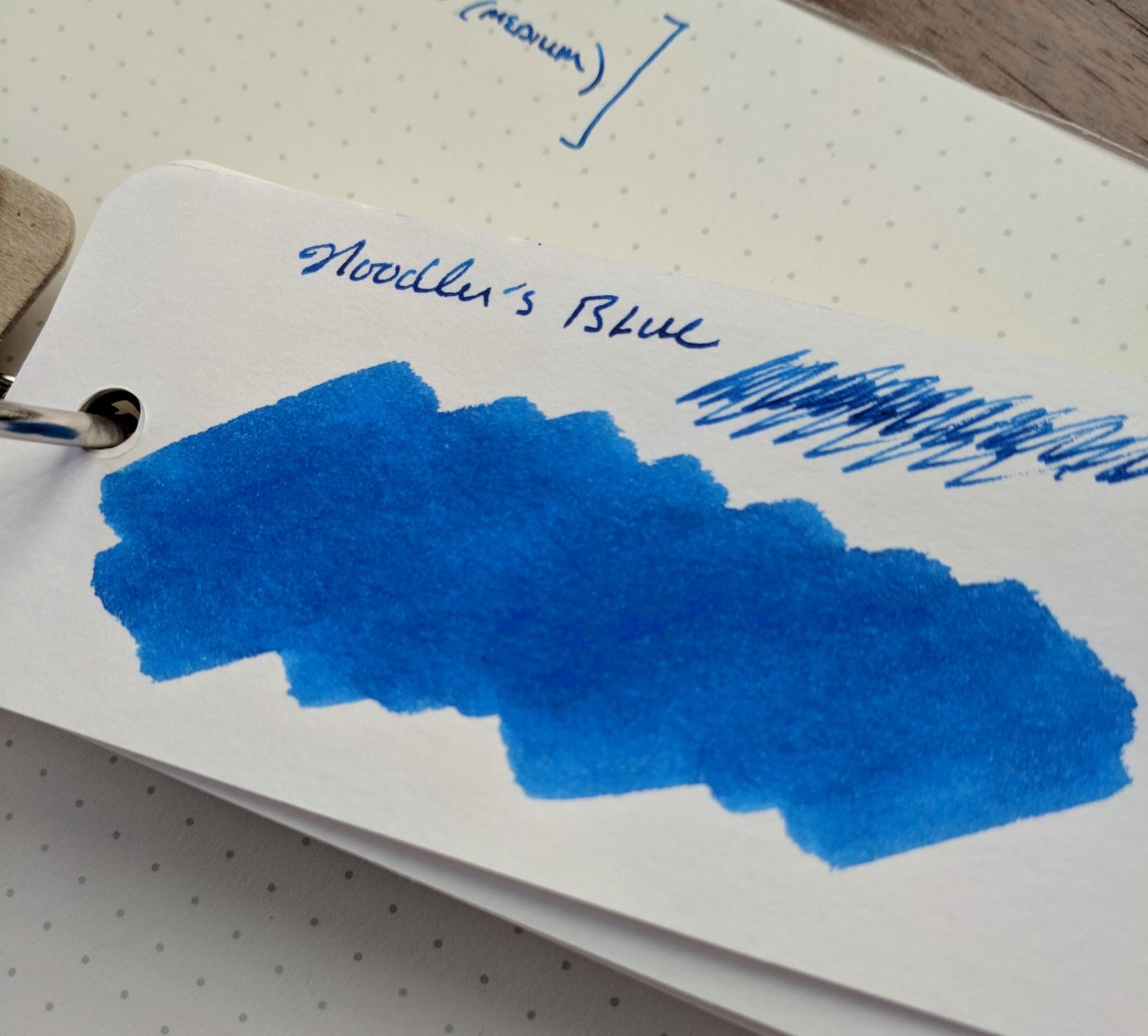 Ink swab on a  Col-O-Ring Ink Testing Book .